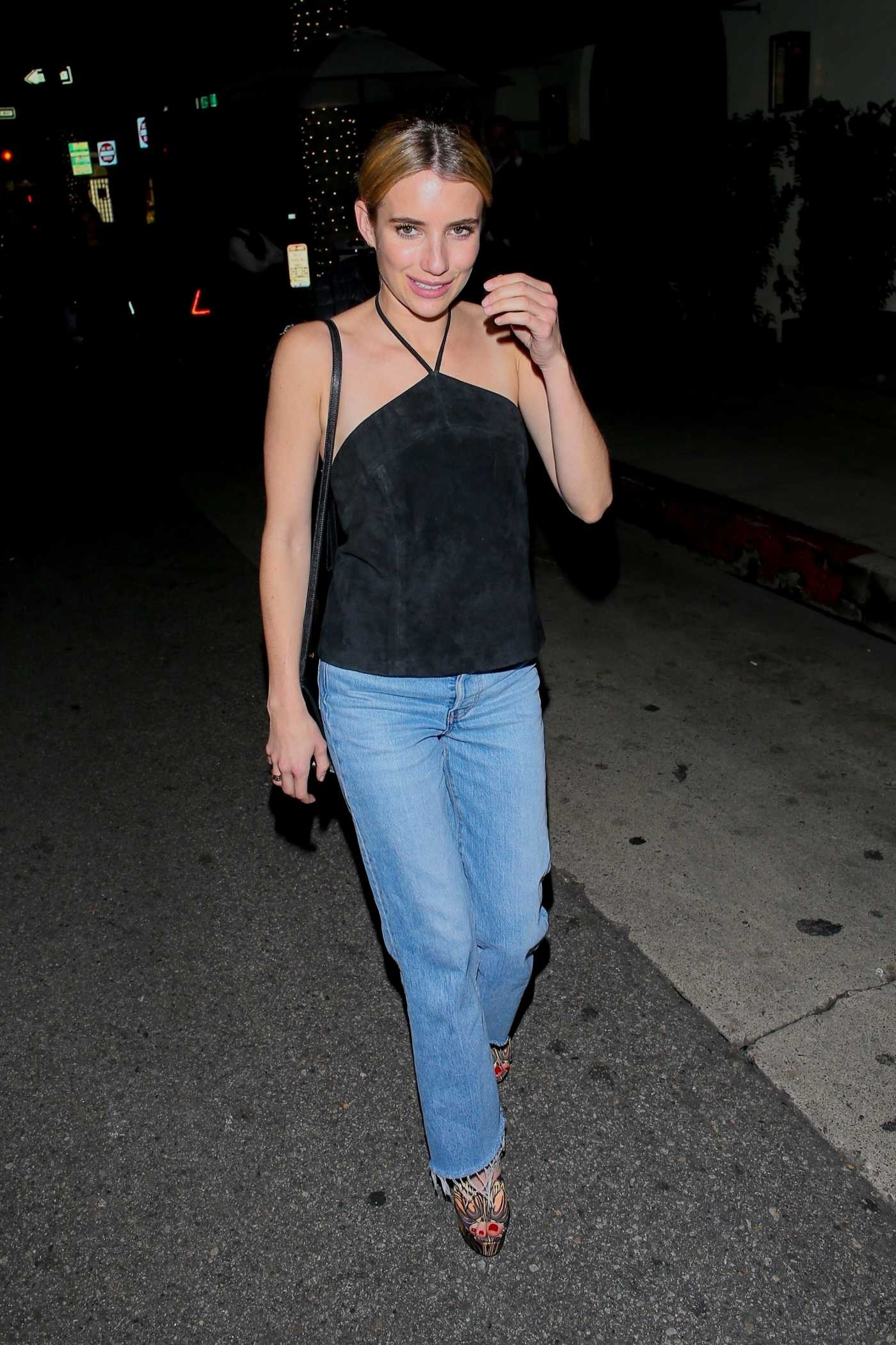Emma Roberts in a Black Blouse Leaves Madeo Restaurant in Beverly Hills 01/31/2020