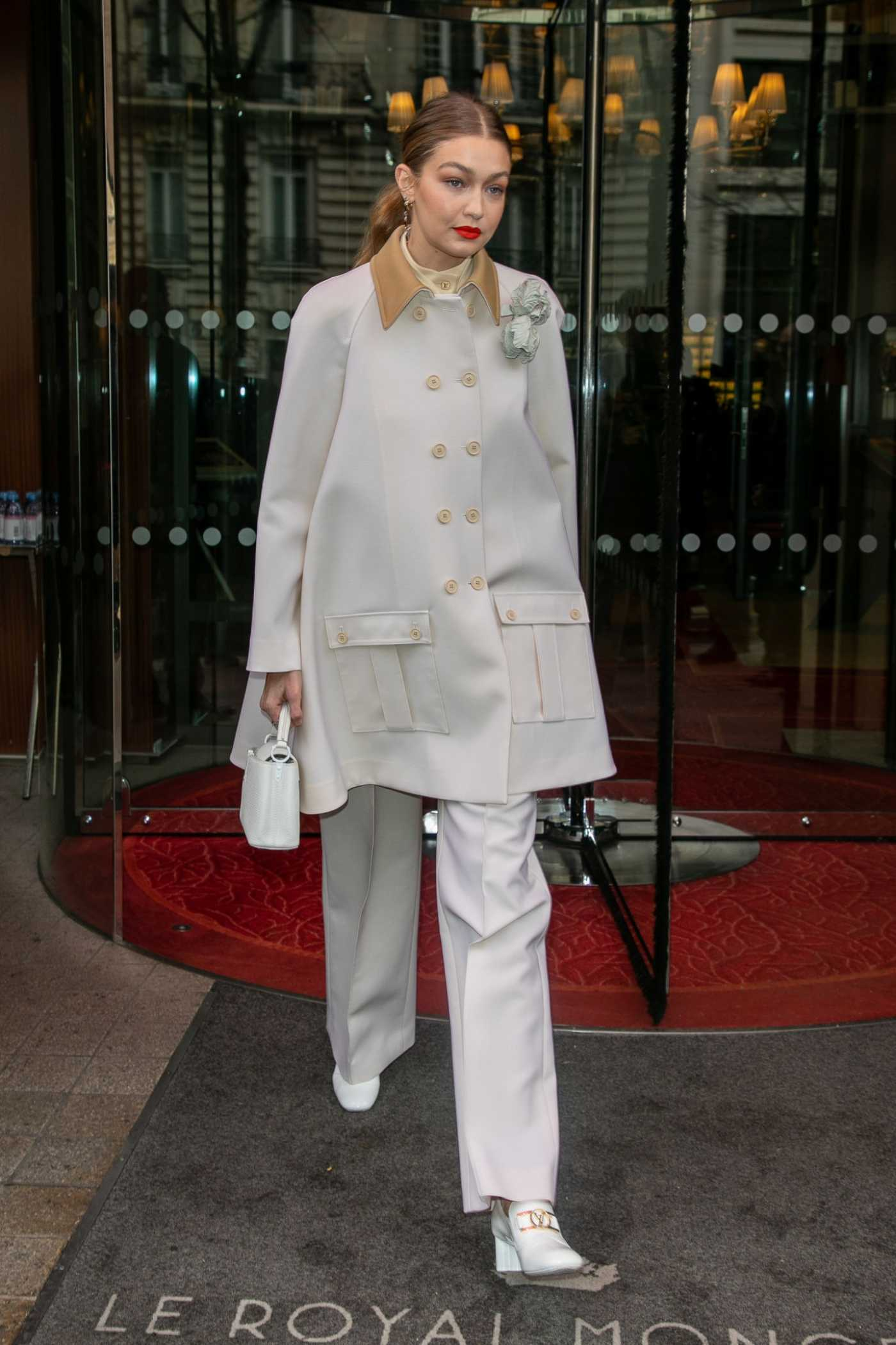 Gigi Hadid in a Beige Coat Leaves the Royal Monceau Hotel in Paris 02/27/2020