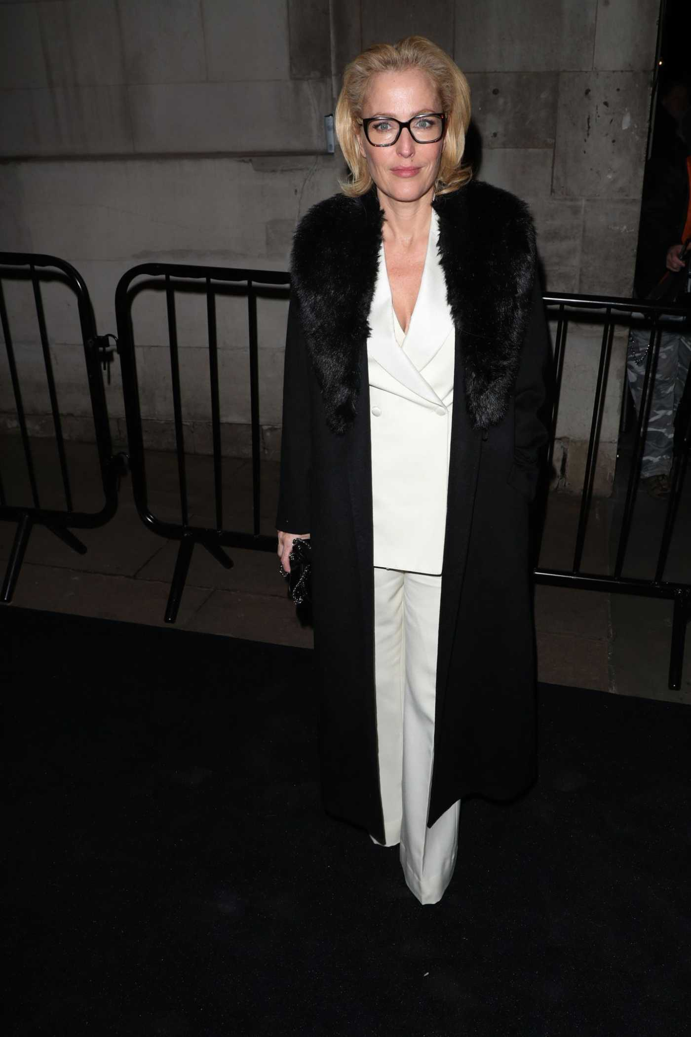 Gillian Anderson Attends 2020 Charles Finch and Chanel Pre-Bafta Party in London 02/01/2020