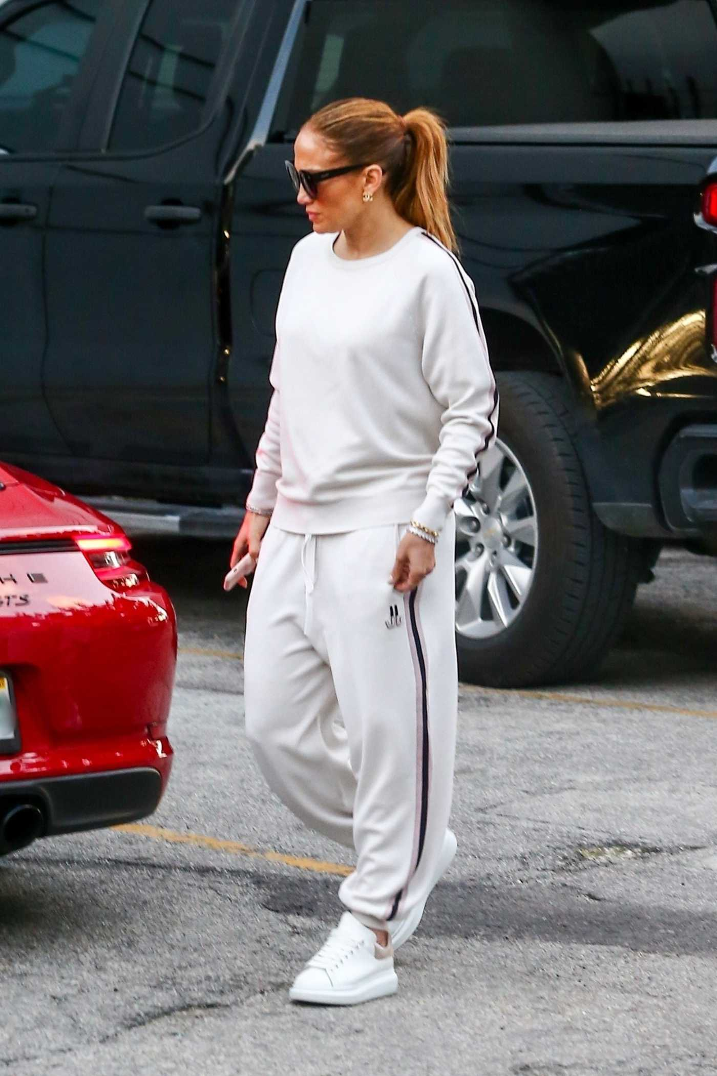 Jennifer Lopez in a White Sneakers Was Seen Out with Alex Rodriguez  in Miami 02/23/2020