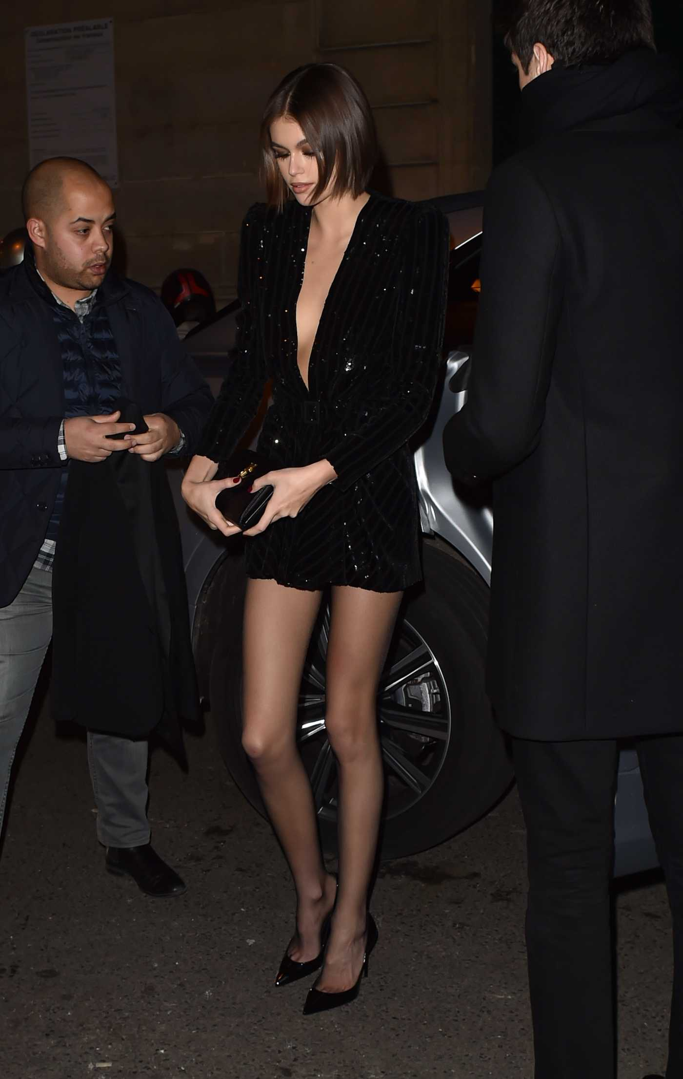 Kaia Gerber in a Black Dress Arrives at the Yves Saint Laurent Dinner Party in Paris 02/27/2020