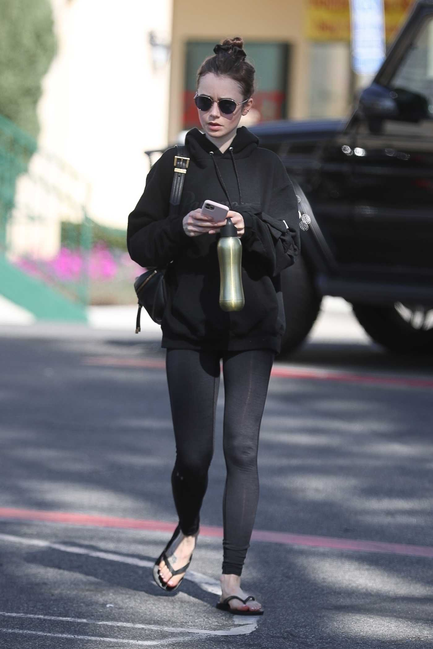 Lily Collins in a Black Hoody Leaves Her Workout in West Hollywood 02/12/2020