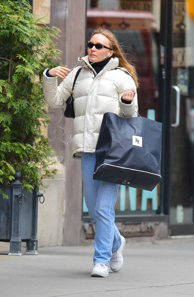 Lily-Rose Depp in a White Puffer Jacket
