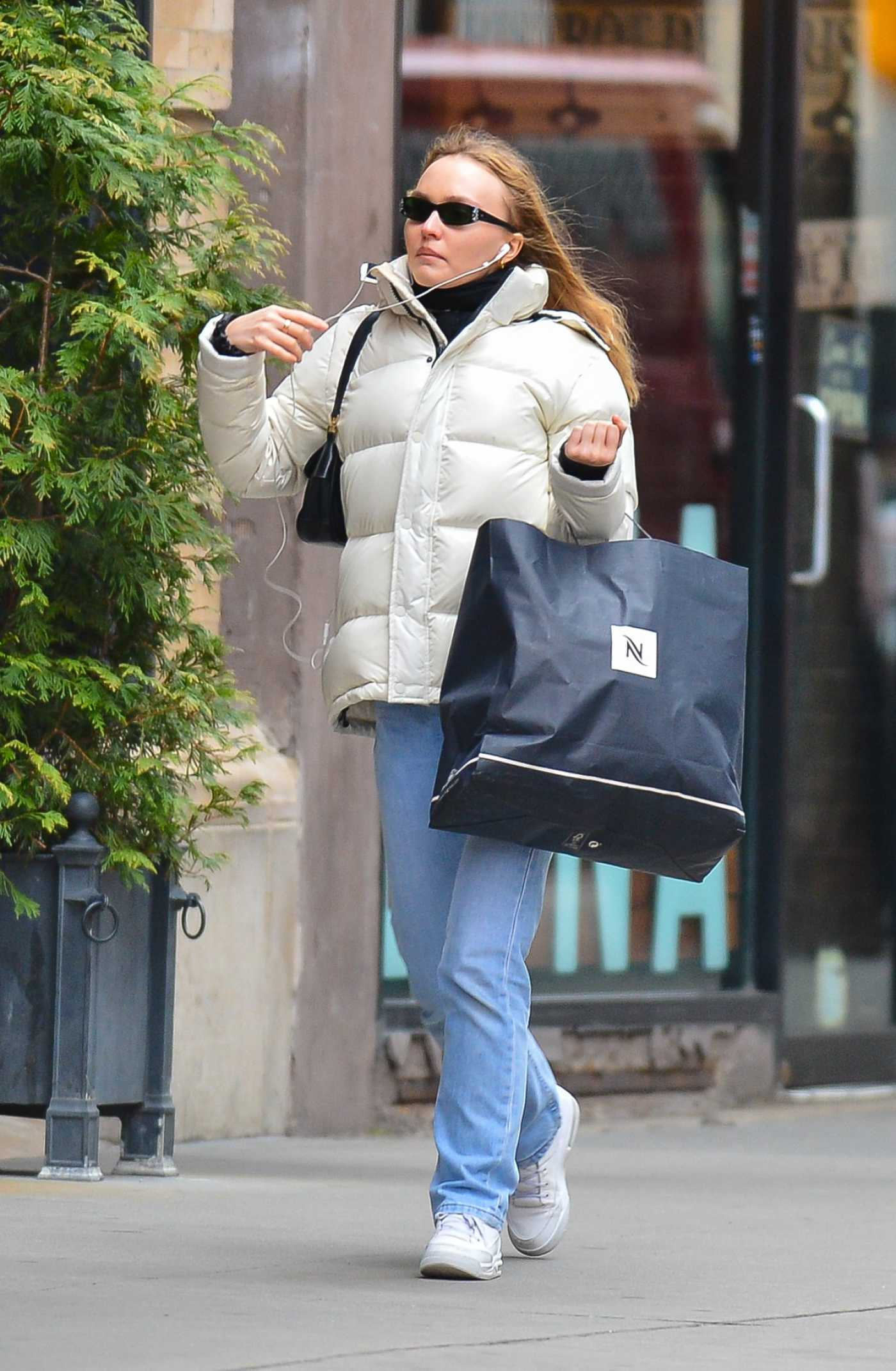 Lily-Rose Depp in a White Puffer Jacket Was Seen Out in New York City 01/29/2020