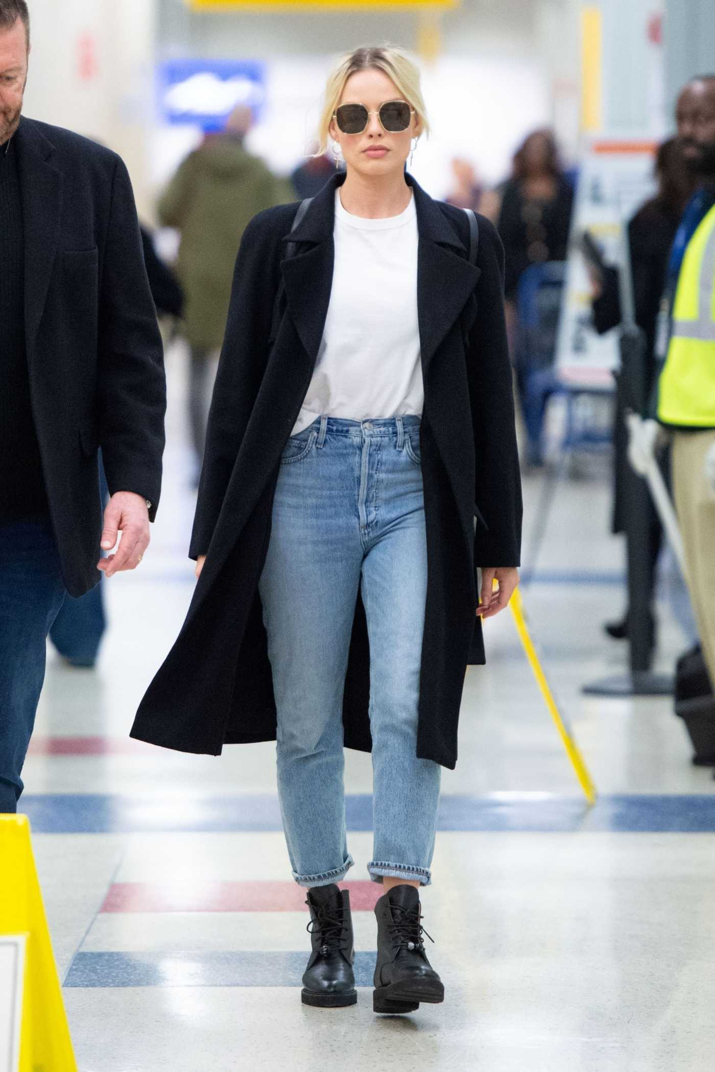 Margot Robbie in a Black Coat Arrives at JFK Airport in New York City 02/03/2020