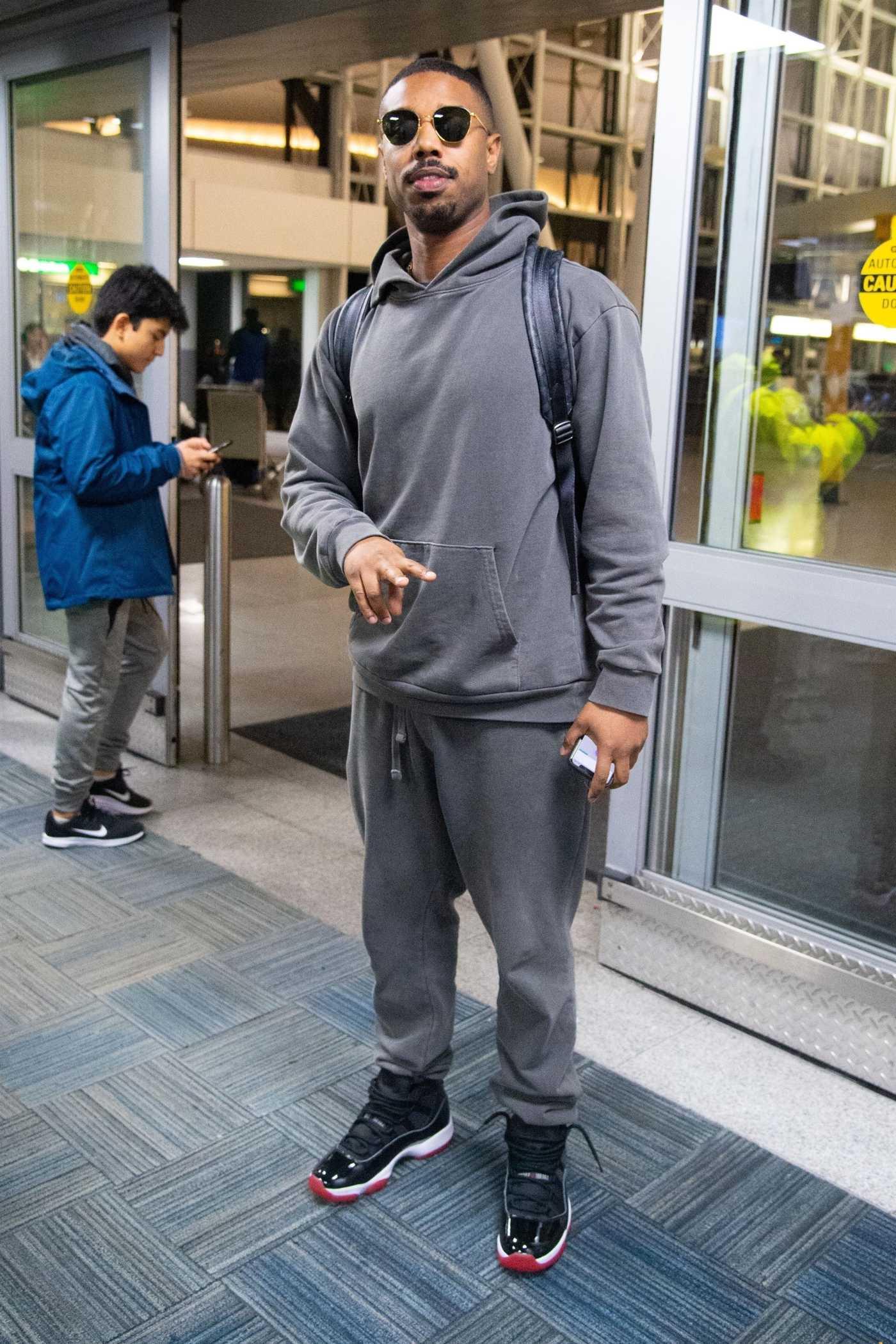 Michael B Jordan in a Gray Hoody Arrives at JFK Airport in New York 02/10/2020