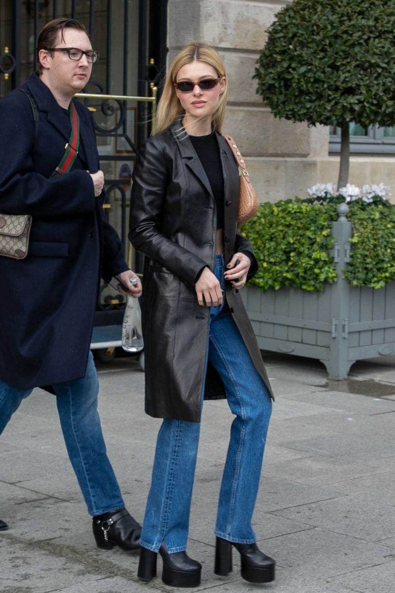 Nicola Peltz in a Black Leather Trench Coat