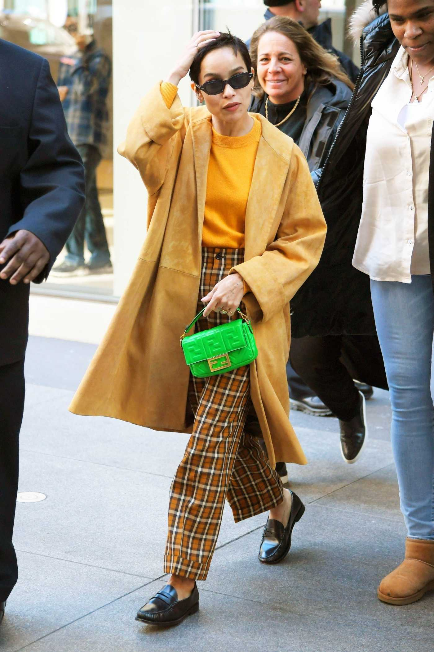 Zoe Kravitz in a Yellow Trench Coat Leaves SiriusXM Townhall in NYC 02/14/2020