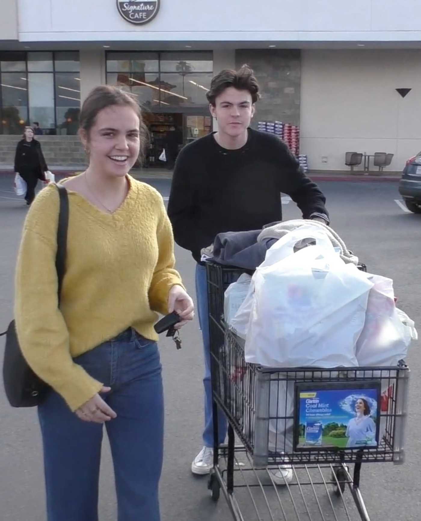 Bailee Madison in a Yellow Sweatshirt Goes Grocery Shopping Out with Blake Richardson in Burbank 03/20/2020