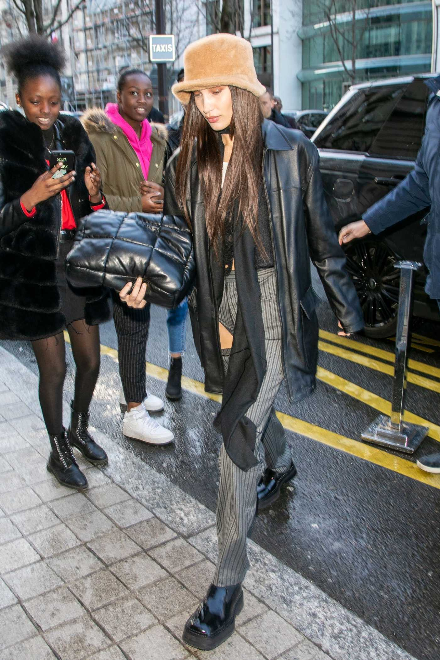 Bella Hadid in a Tan Hat Arrives at the Royal Monceau Hotel in Paris 02/29/2020