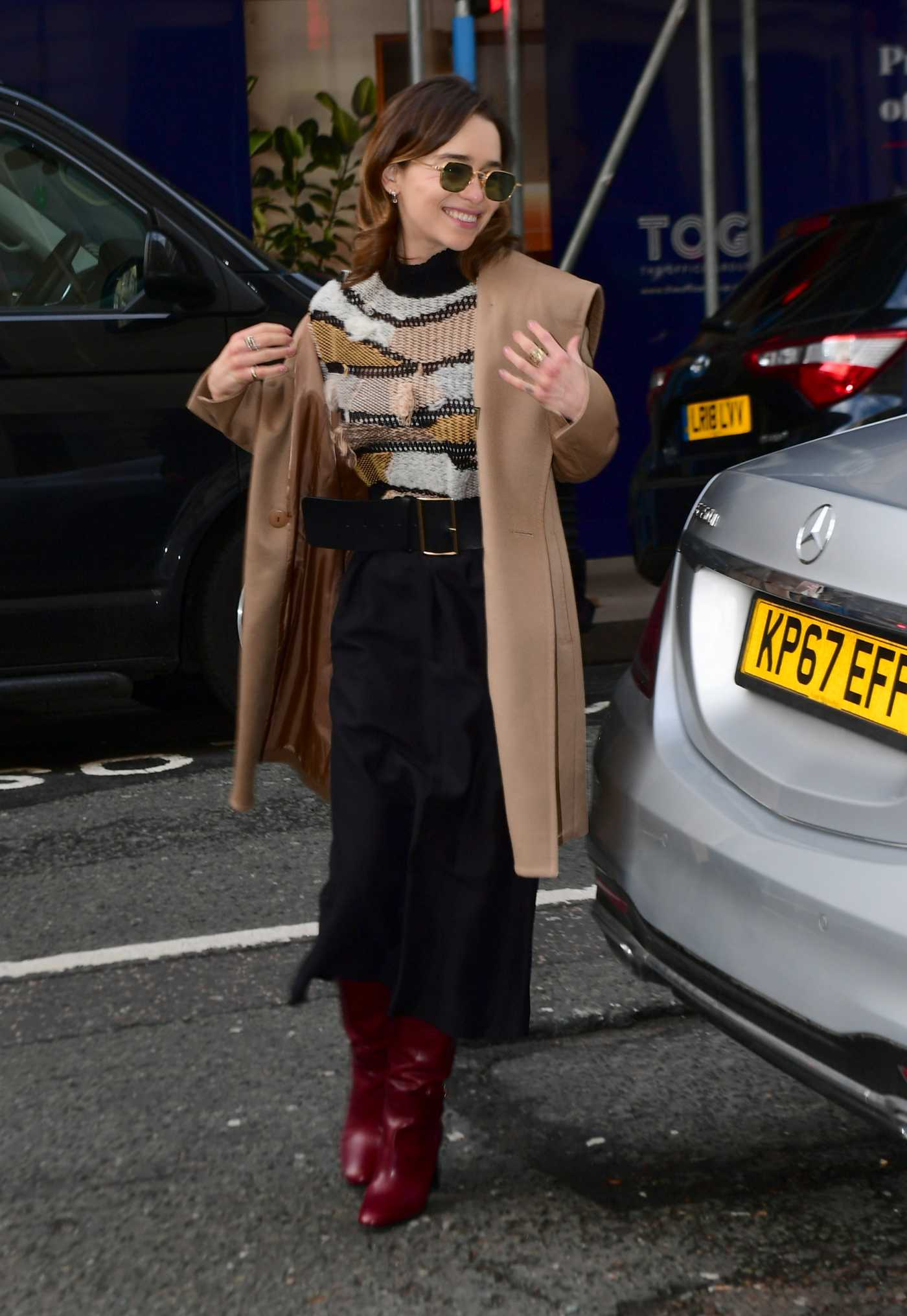 Emilia Clarke in a Beige Coat Arrives at BBC Radio 2 Studios in London 03/03/2020