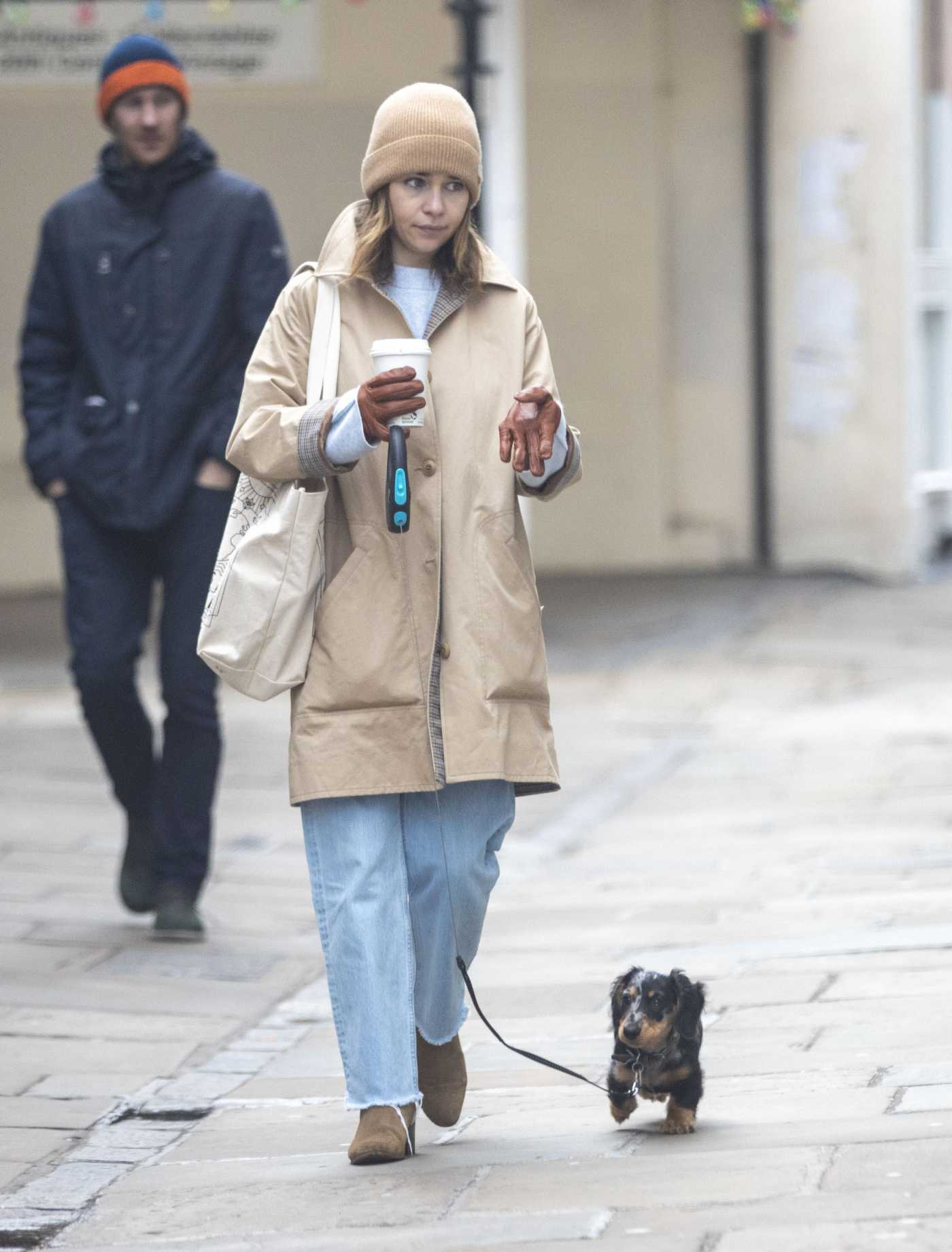Emilia Clarke in a Beige Trench Coat Walks Her Dog Out in London 03/20/2020