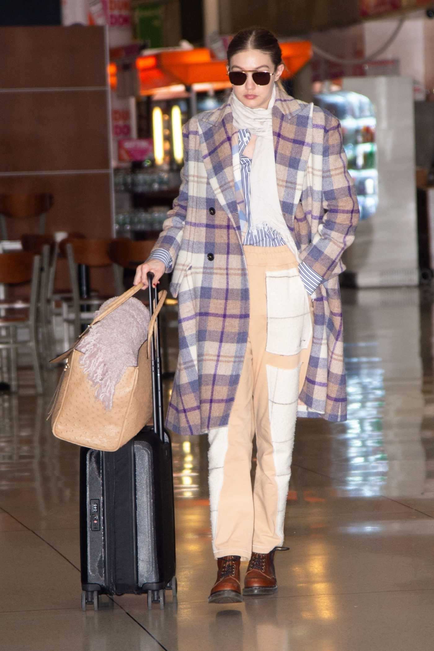 Gigi Hadid in a Plaid Coat Arrives at JFK Airport in New York City 03/03/2020