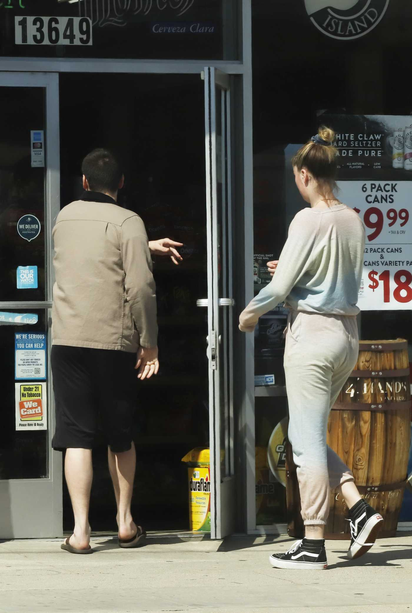 Ireland Baldwin in a Black Vans Sneakers Heads to a Liquor Store in Los Angeles 03/22/2020