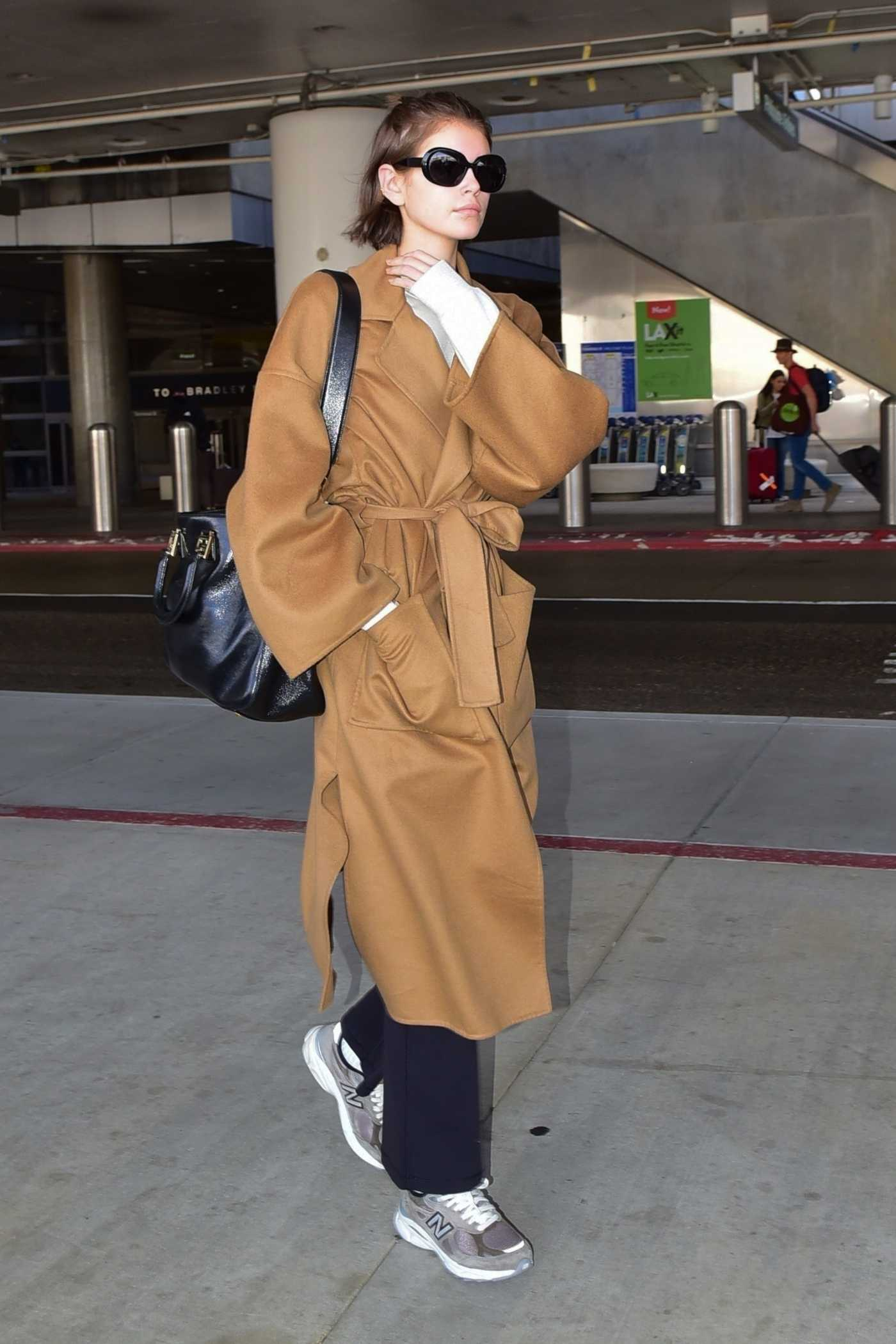 Kaia Gerber in a Tan Coat Arrives at LAX Airport in LA 03/05/2020