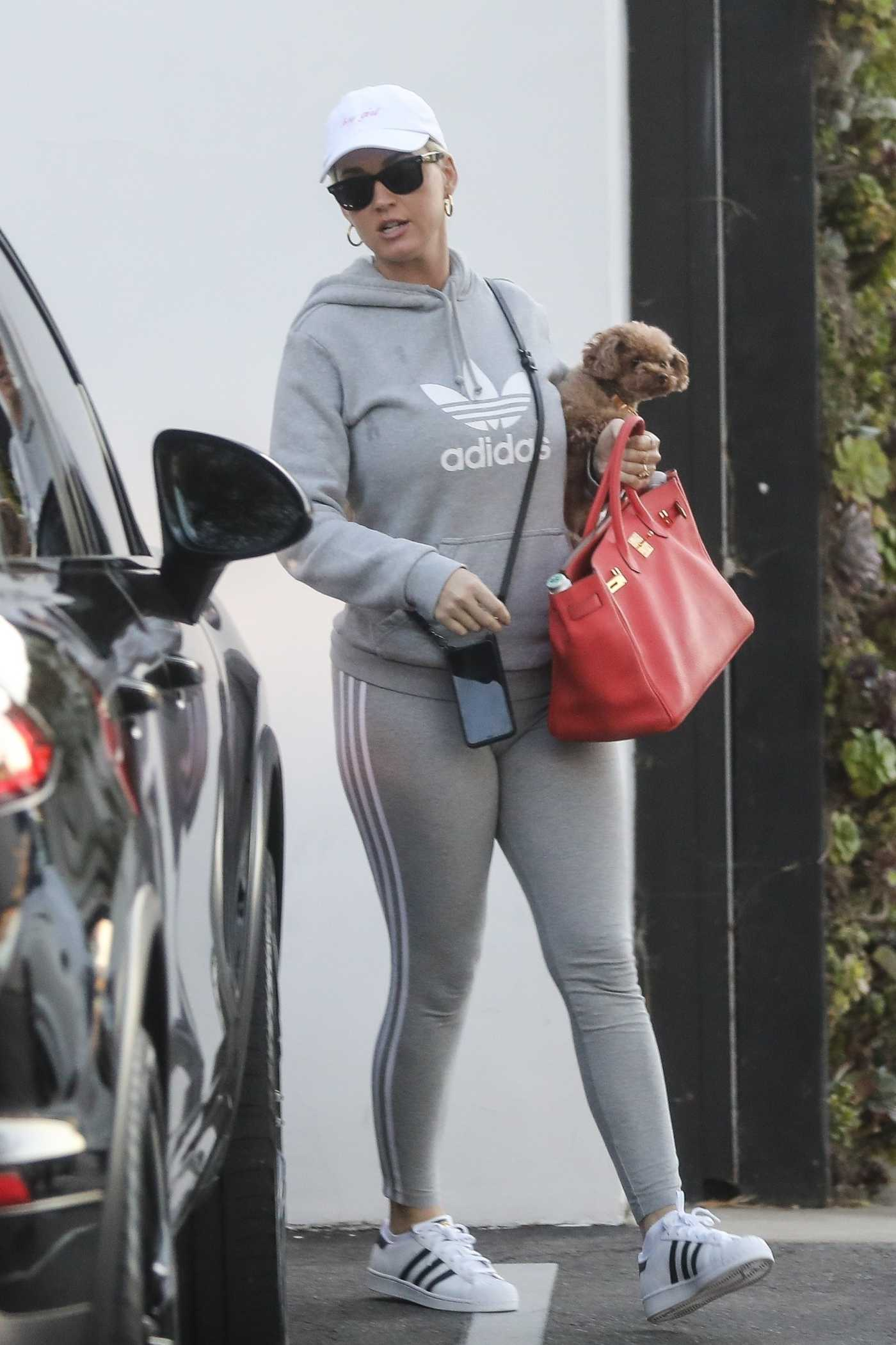 Katy Perry in a White Cap Leaves Her Office in West Hollywood 03/03/2020