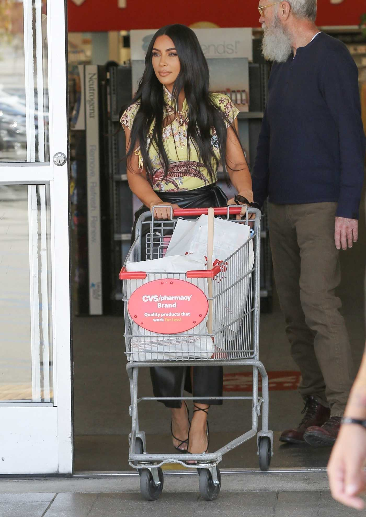 Kim Kardashian in a Black Skirt Hits up CVS with David Letterman with a Film Crew in Calabasas 03/05/2020