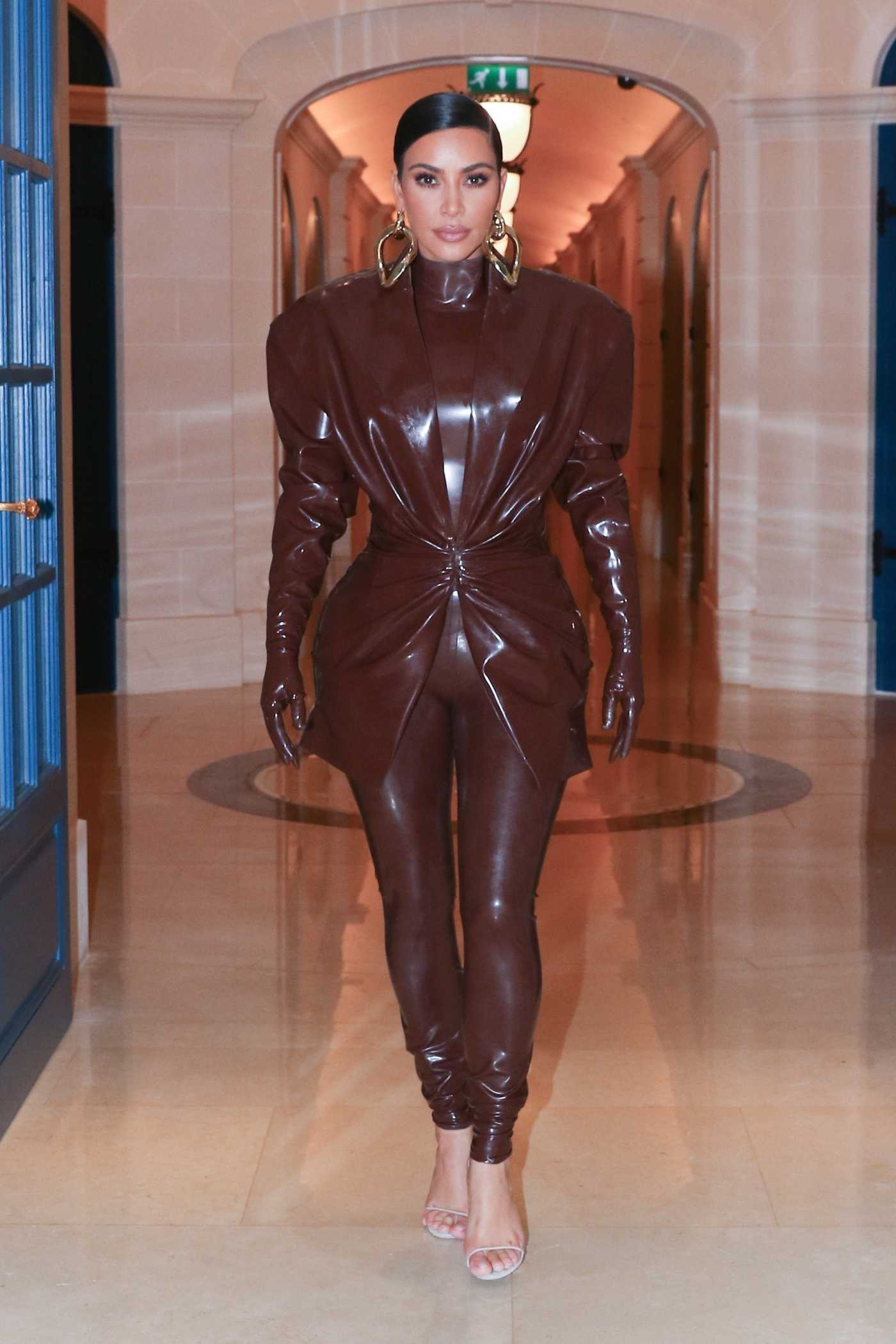 Kim Kardashian in a Brown Latex Outfit Leaves Her Hotel in Paris 03/01/2020