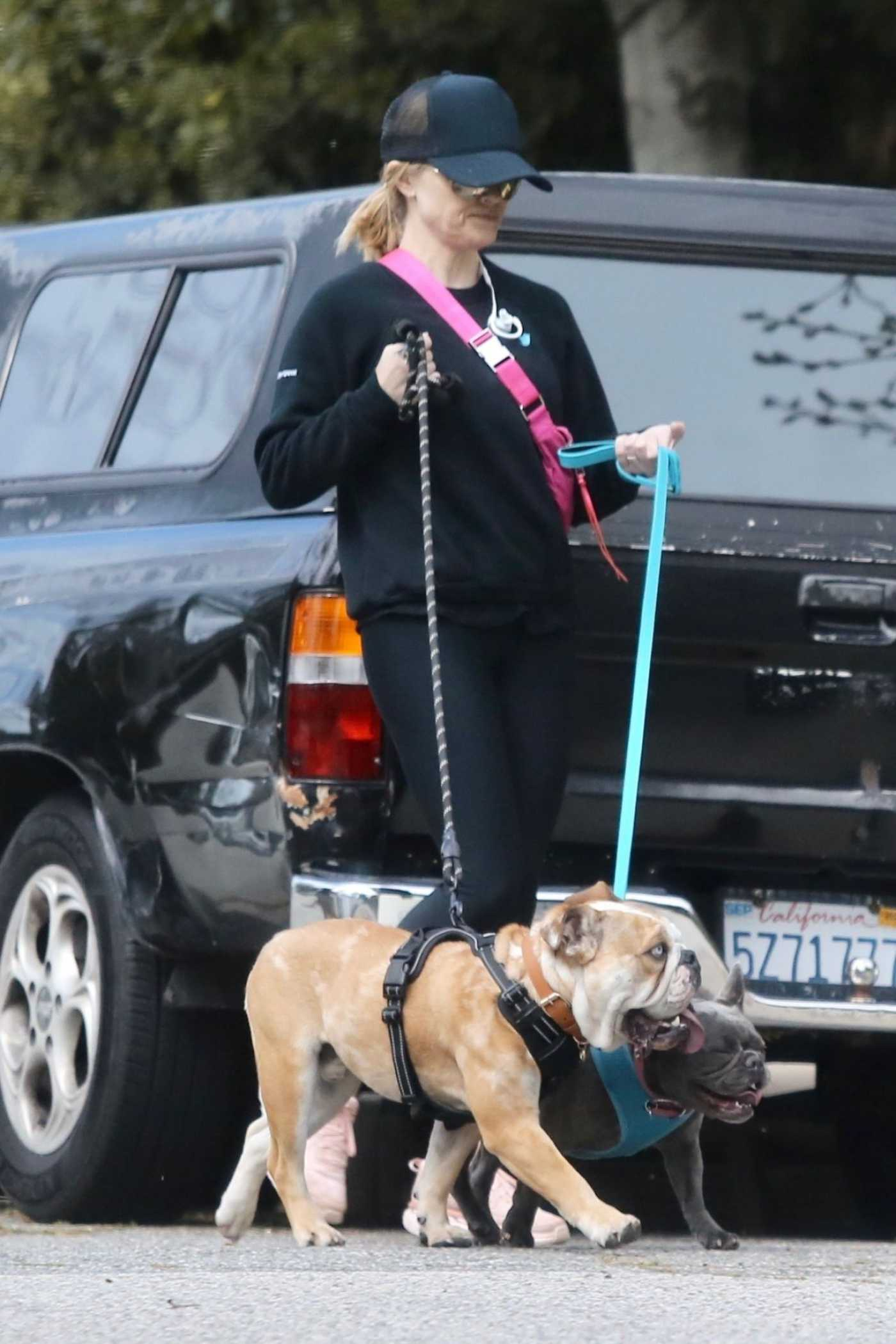 Reese Witherspoon in a Black Cap Walks Her Dogs in Pacific Palisades 03/24/2020