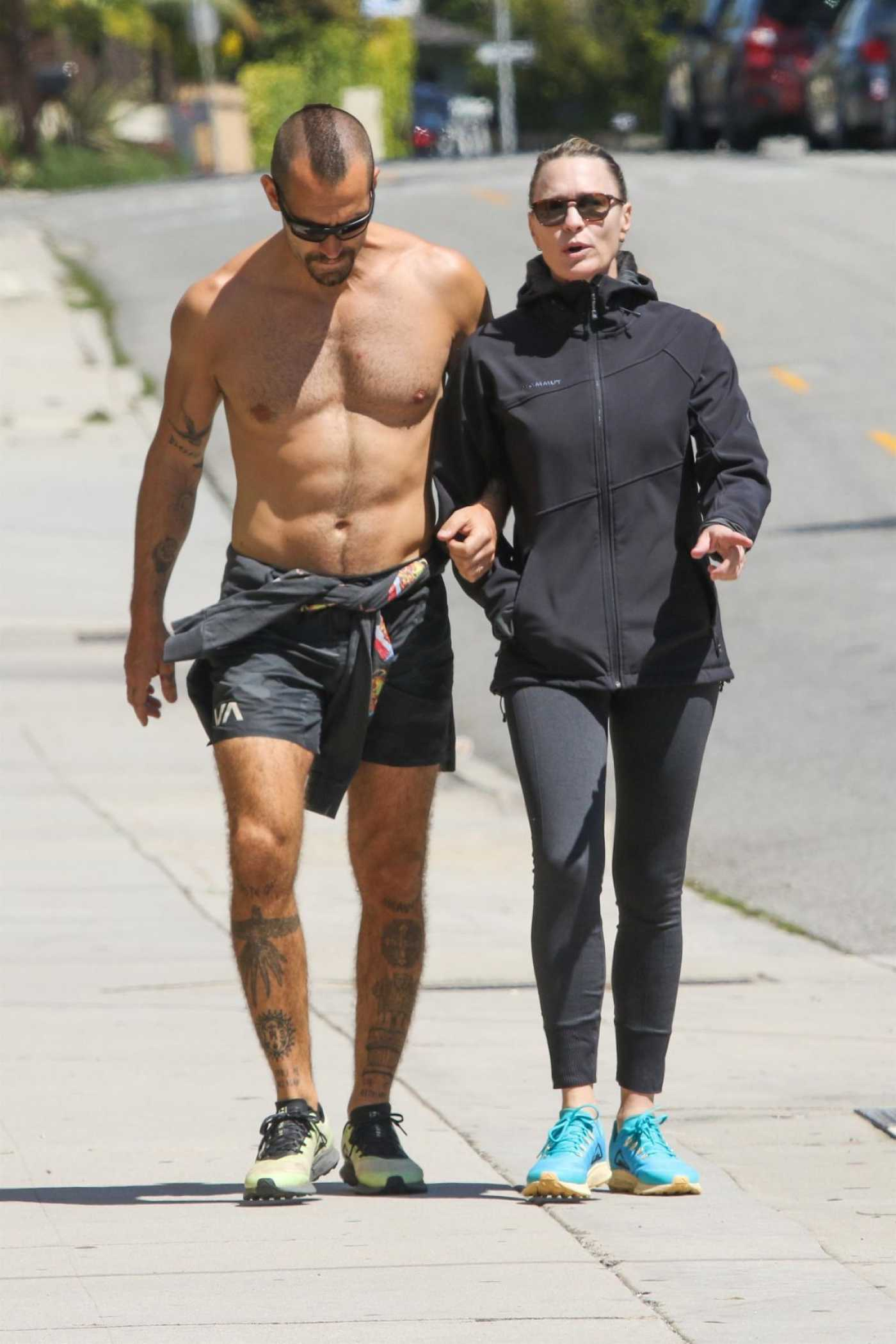 Robin Wright in a Black Leggings Was Seen Out with Clement Giraudet in Santa Monica 03/27/2020