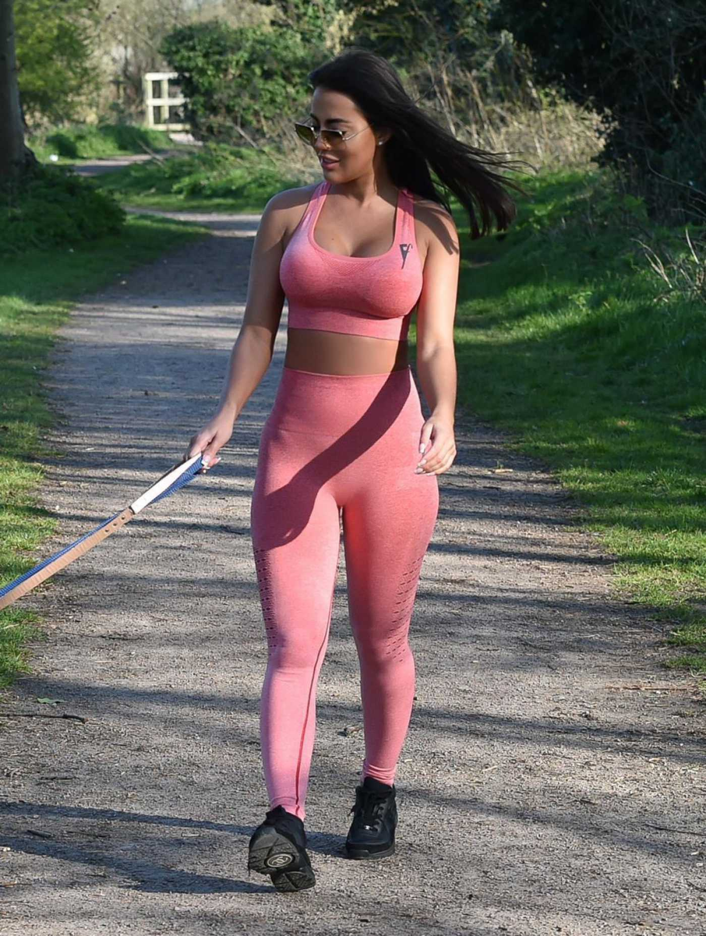 Yazmin Oukhellou in a Pink Leggings Walks Her Dogs in Harlow 03/27/2020