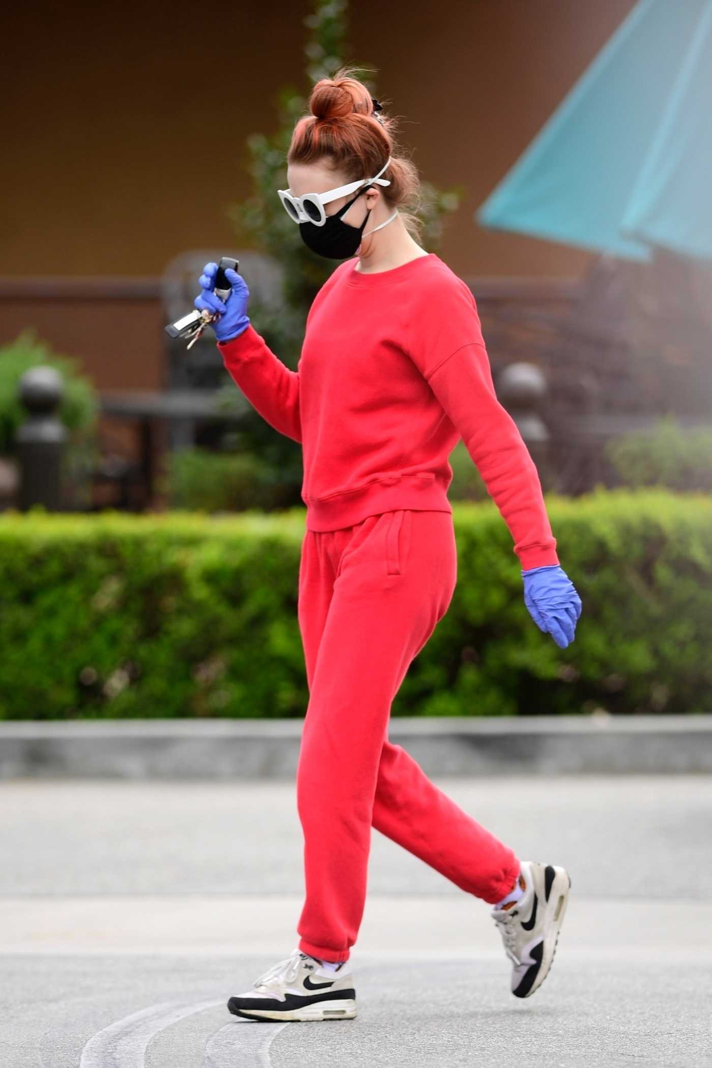 Alessandra Torresani in a Red Sweatsuit Goes Grocery Shopping During the COVID-19 Lockdown in Los Angeles 04/20/2020