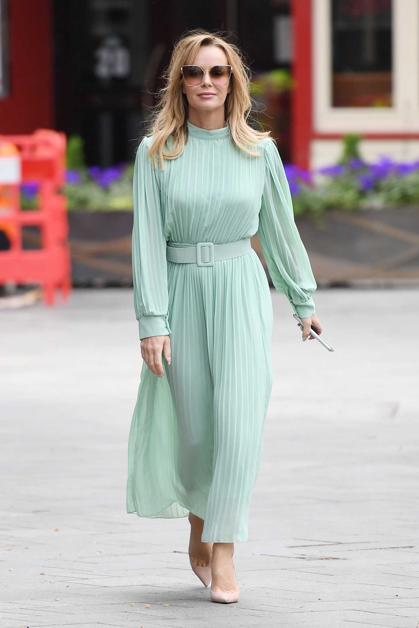 Amanda Holden in a Green Dress Arrives at Heart Breakfast at the Global House in London 04/17/2020