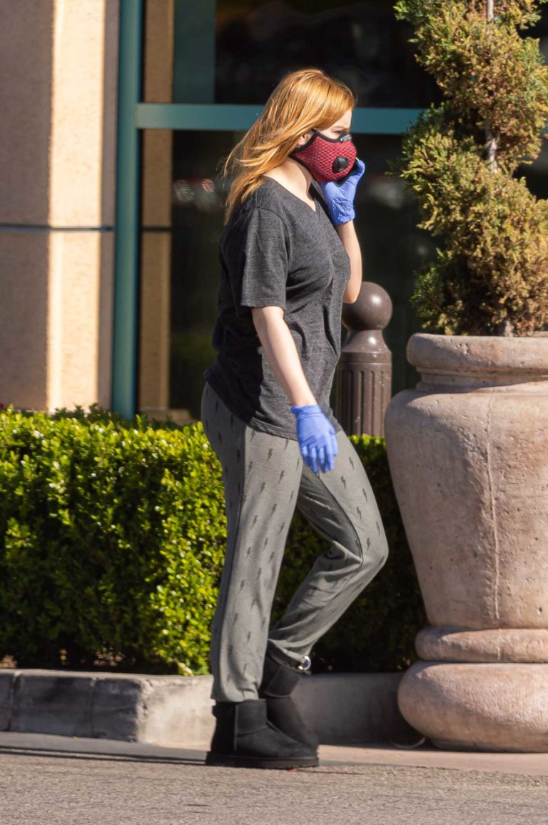 Ariel Winter in a Red Face Mask