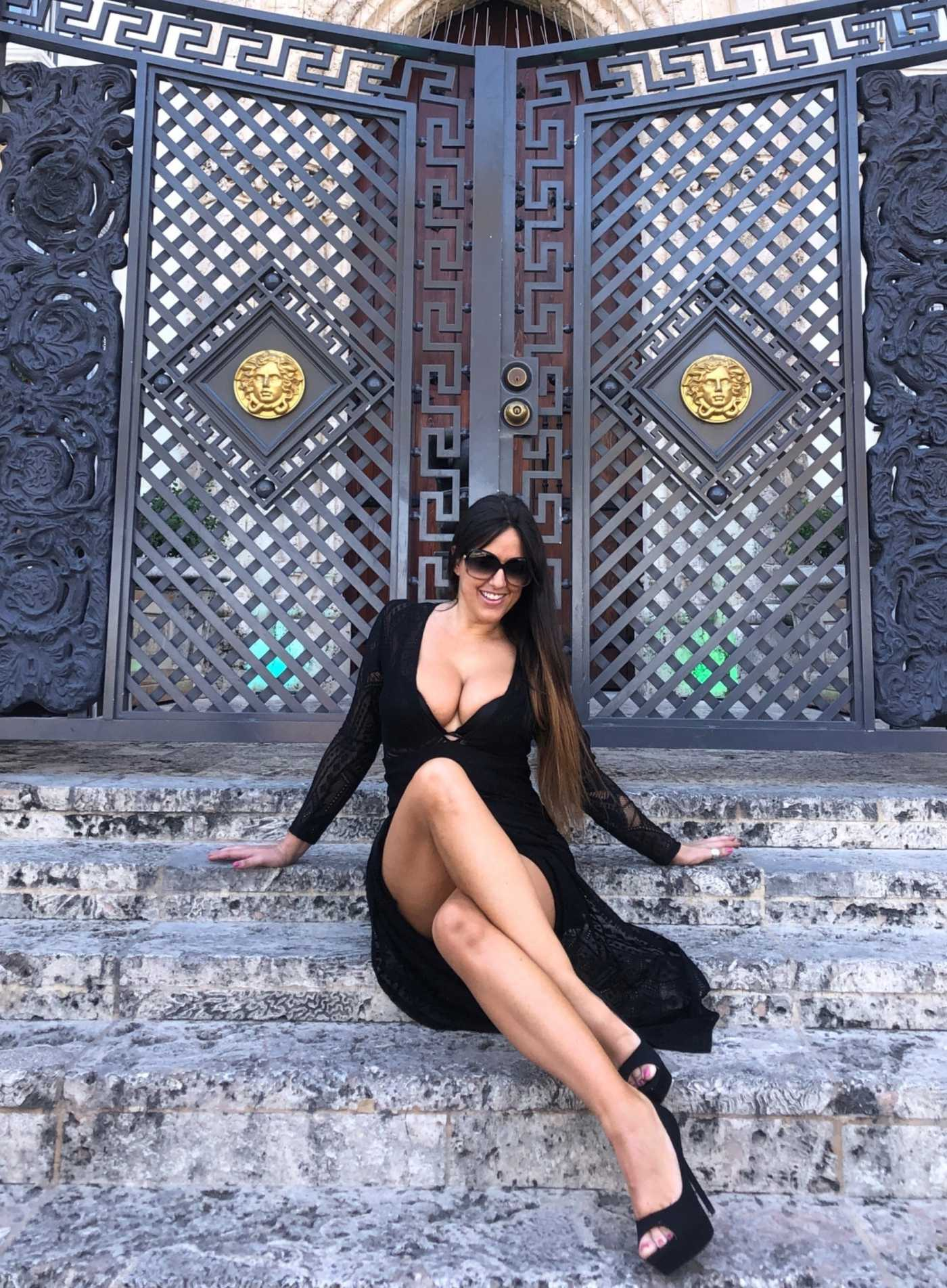 Claudia Romani in a Black Dress Posing by the South Beach Landmark Versace Mansion in Miami Beach 04/21/2020