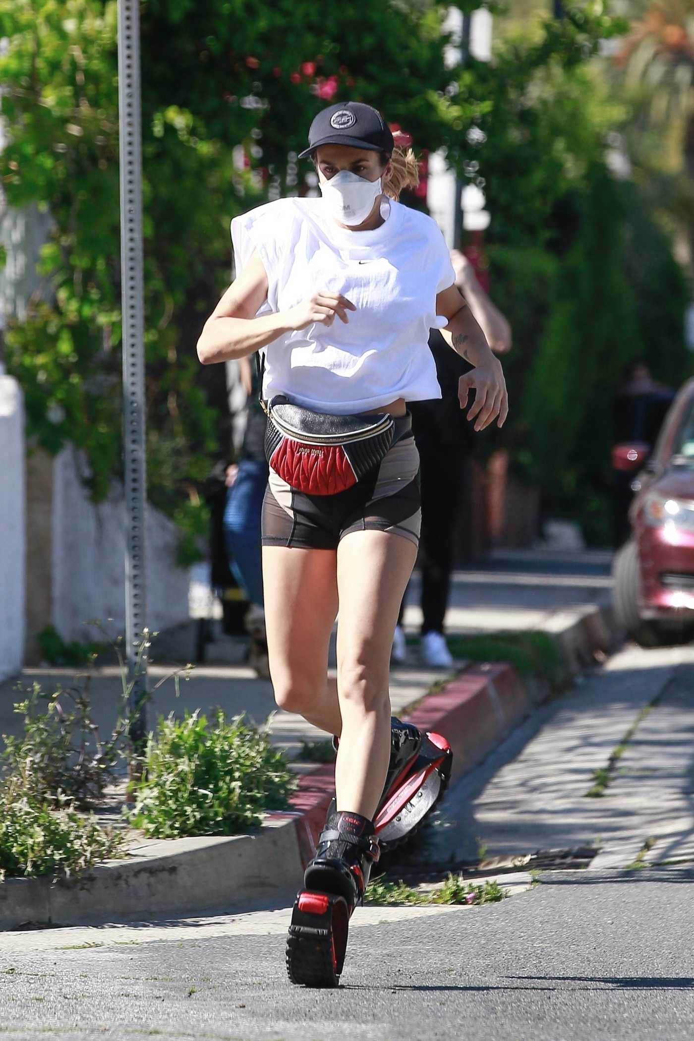 Elisabetta Canalis in a Face Mask Enjoys a Jog in Kangaroo Jumps in Los Angeles 04/15/2020