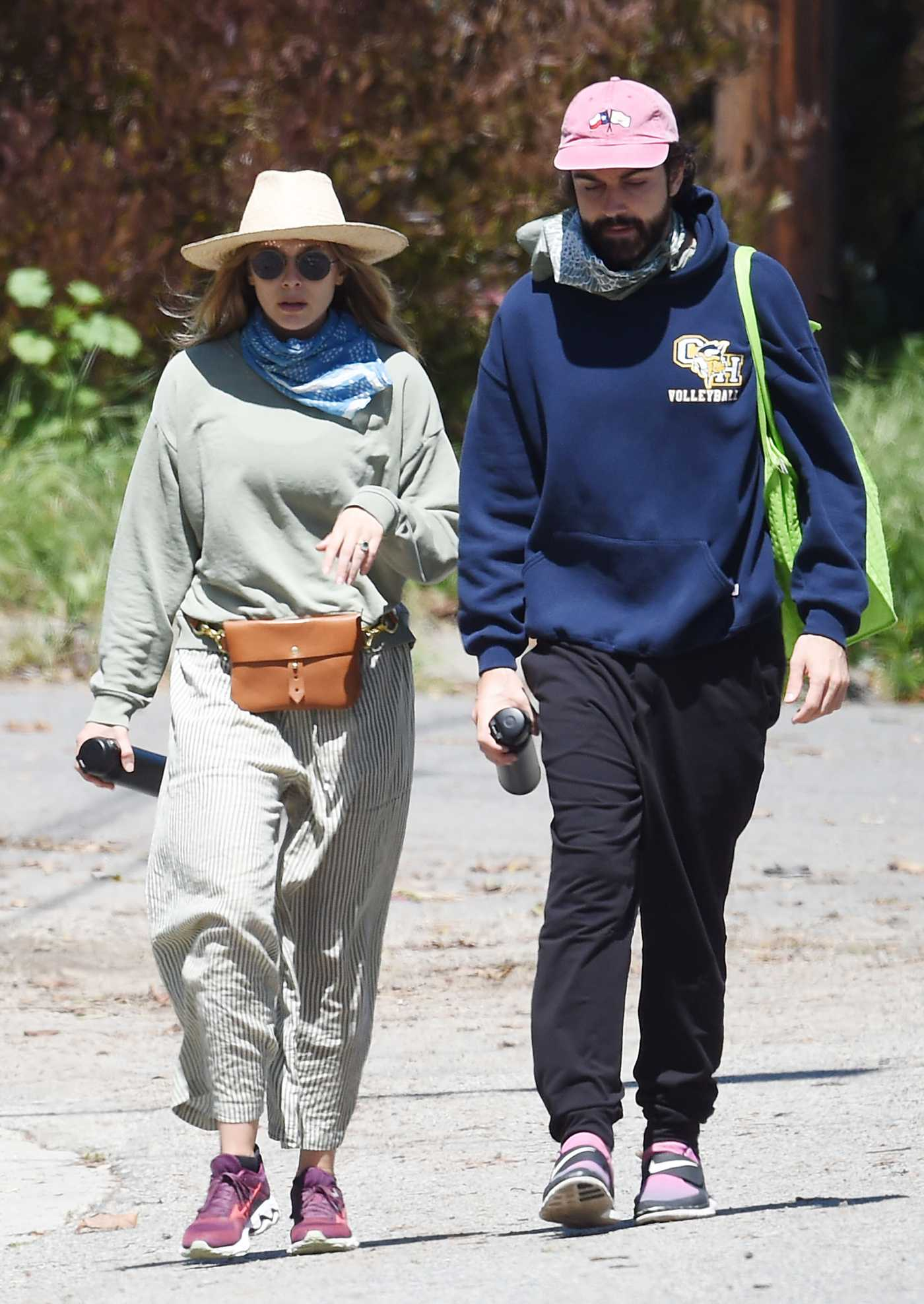 Elizabeth Olsen in a Striped Pants Walks Out with Robbie Arnett in Hollywood 04/11/2020