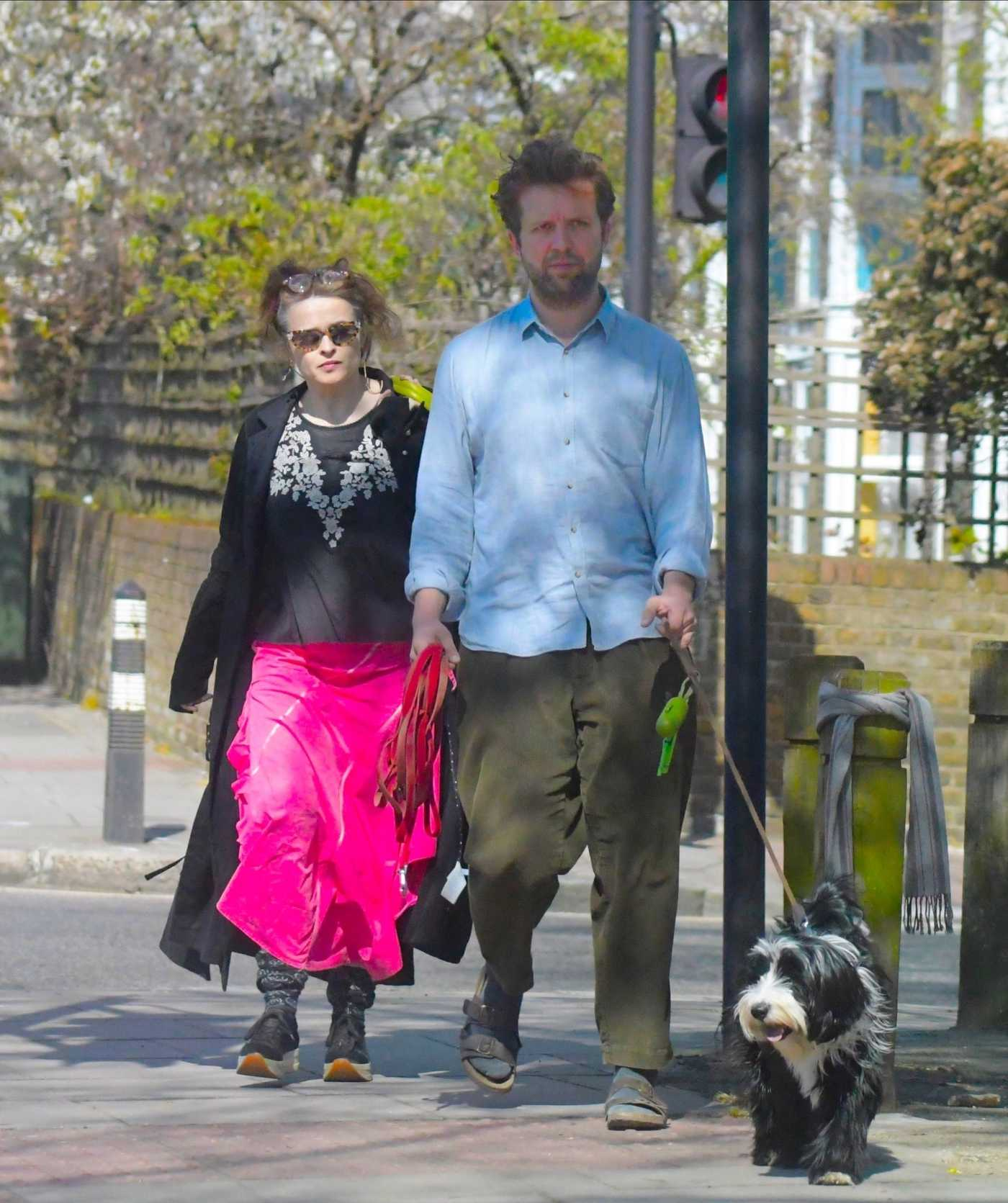 Helena Bonham Carter in a Black Coat Walks Her Dog Out with Rye Dag Holmboe in London 04/04/2020