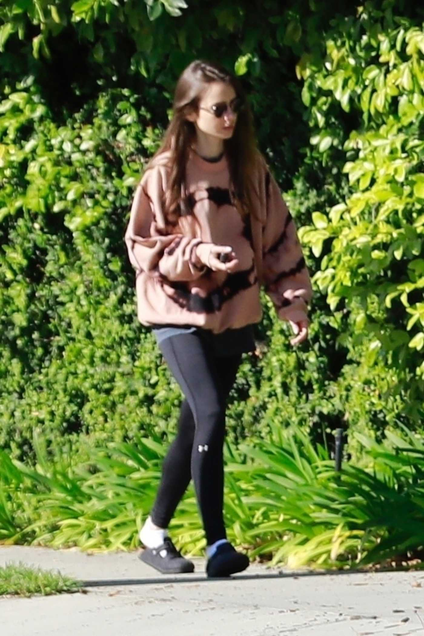 Lily Collins in a Black Leggings Does a Morning Walk in Beverly Hills 04/07/2020