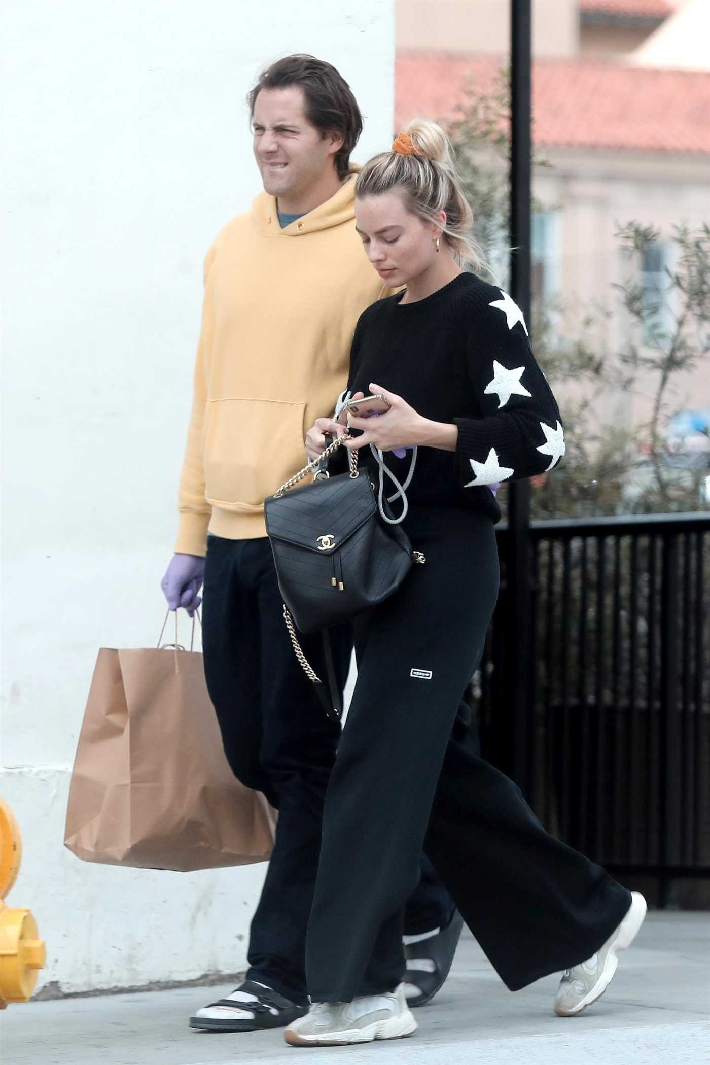 Margot Robbie in a Black Pants Was Seen Out with Tom Ackerley in Los Angeles 03/31/2020