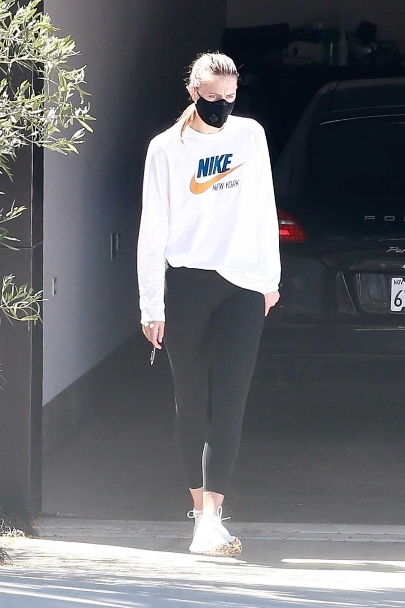Maria Sharapova in a White Nike Sweatshirt Was Seen Out  in Manhattan Beach 04/21/2020