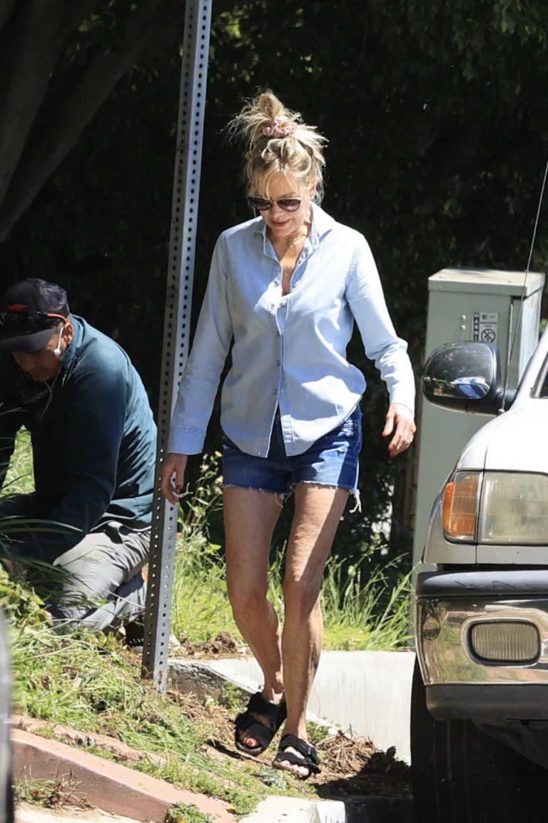Melanie Griffith in a Blue Denim Shorts