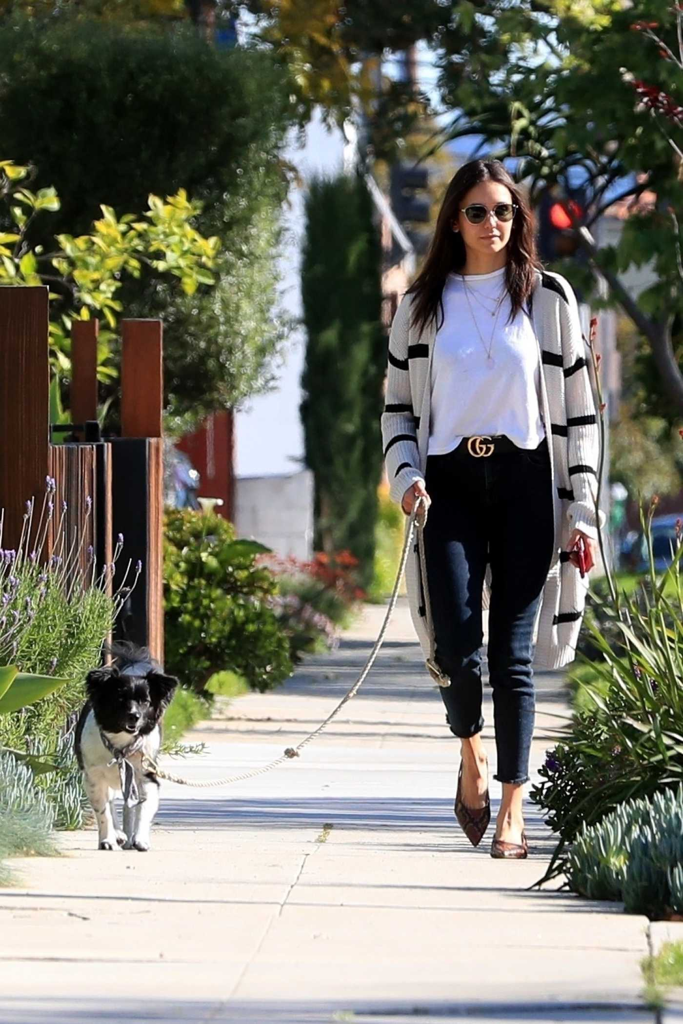 Nina Dobrev in a Striped Cardigan Walks Her Dog Out in West Hollywood 04/11/2020