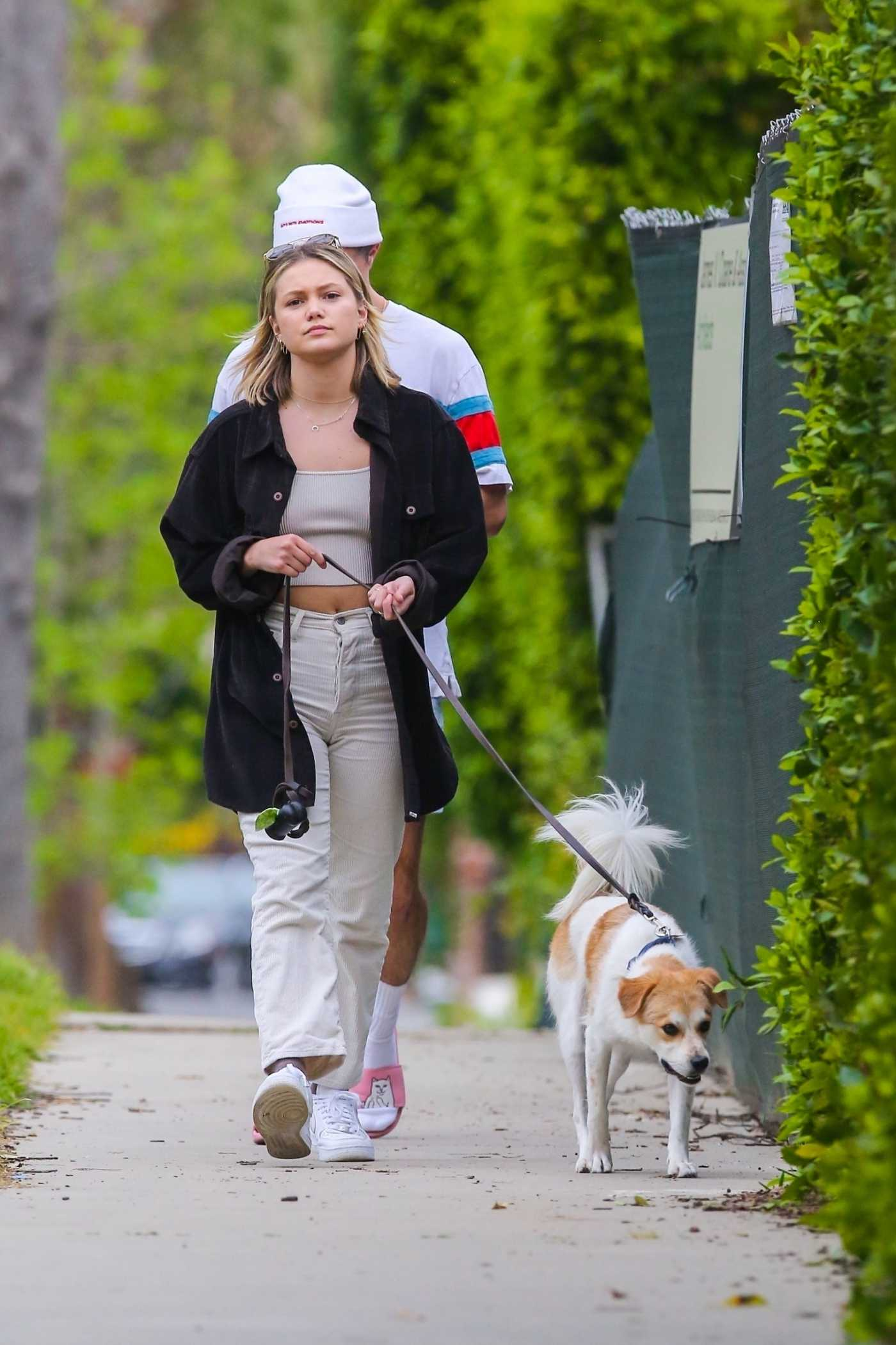 Olivia Holt in a Black Oversized Shirt Walks Her Dog in Los Angeles 03/31/2020
