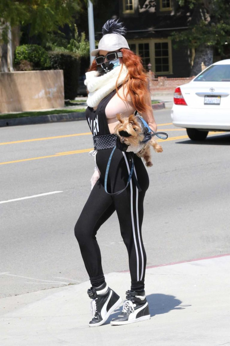Phoebe Price in a Black Tank Top