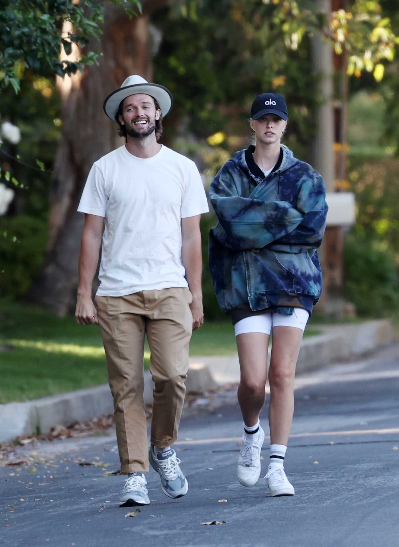 Abby Champion in a White Sneakers Enjoys a Romantic Walk Out with Patrick Schwarzenegger in Pacific Palisades 05/17/2020
