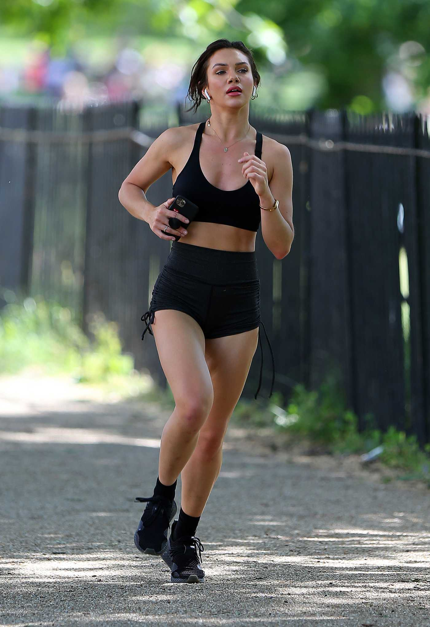 Alexandra Cane in a Black Sports Bra Does a Morning Jog in London 05/25/2020
