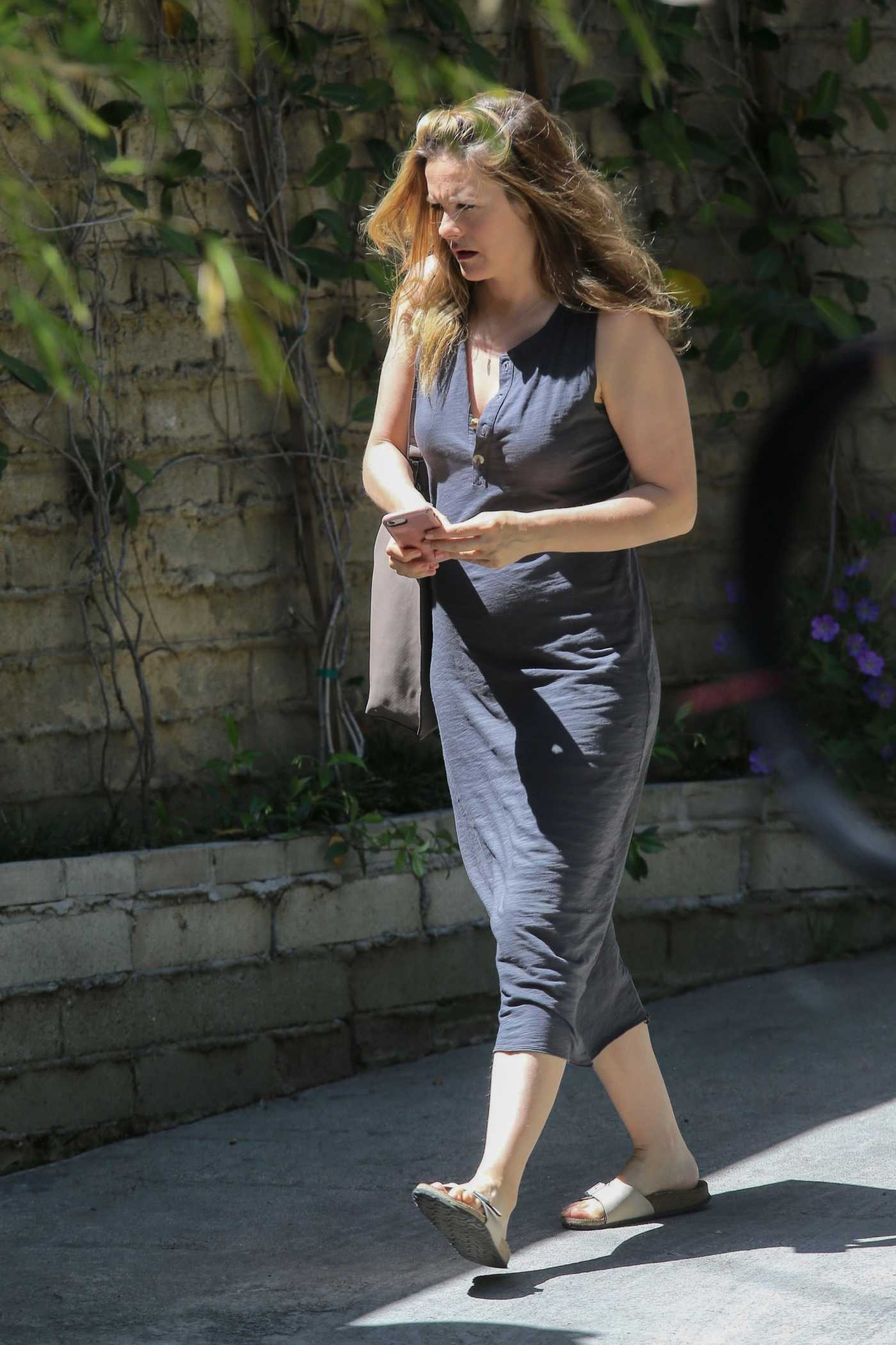 Alicia Silverstone in a Gray Dress Was Seen Out in Los Angeles 05/06/2020
