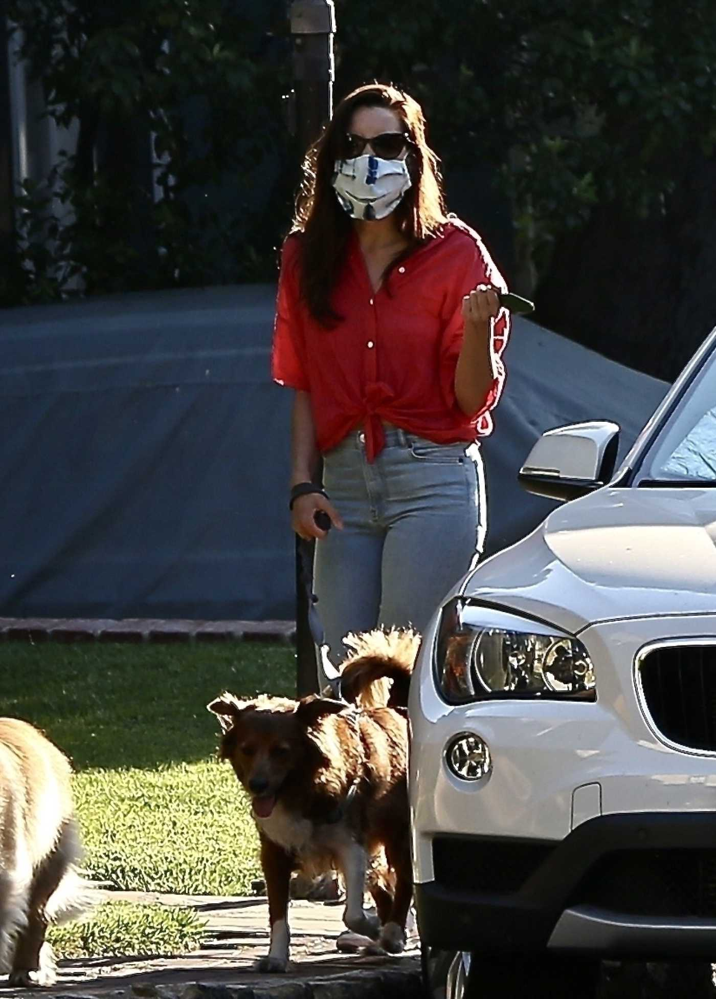 Aubrey Plaza in a Red Shirt Walks Her Dog in Los Angeles 05/11/2020