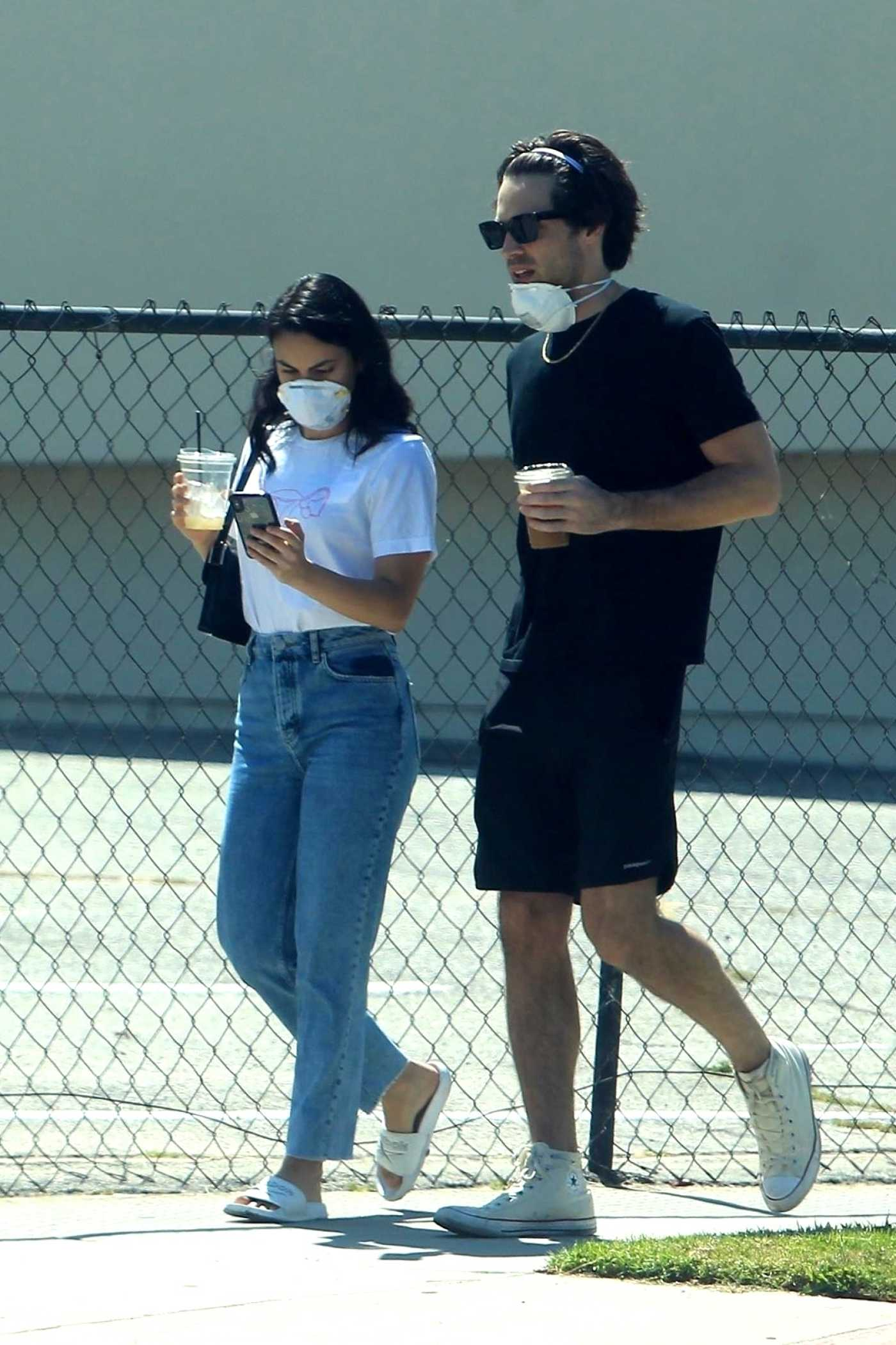 Camila Mendes in a White Tee Enjoys a Stroll with a Mystery Man During Quarantine in Los Angeles 05/08/2020