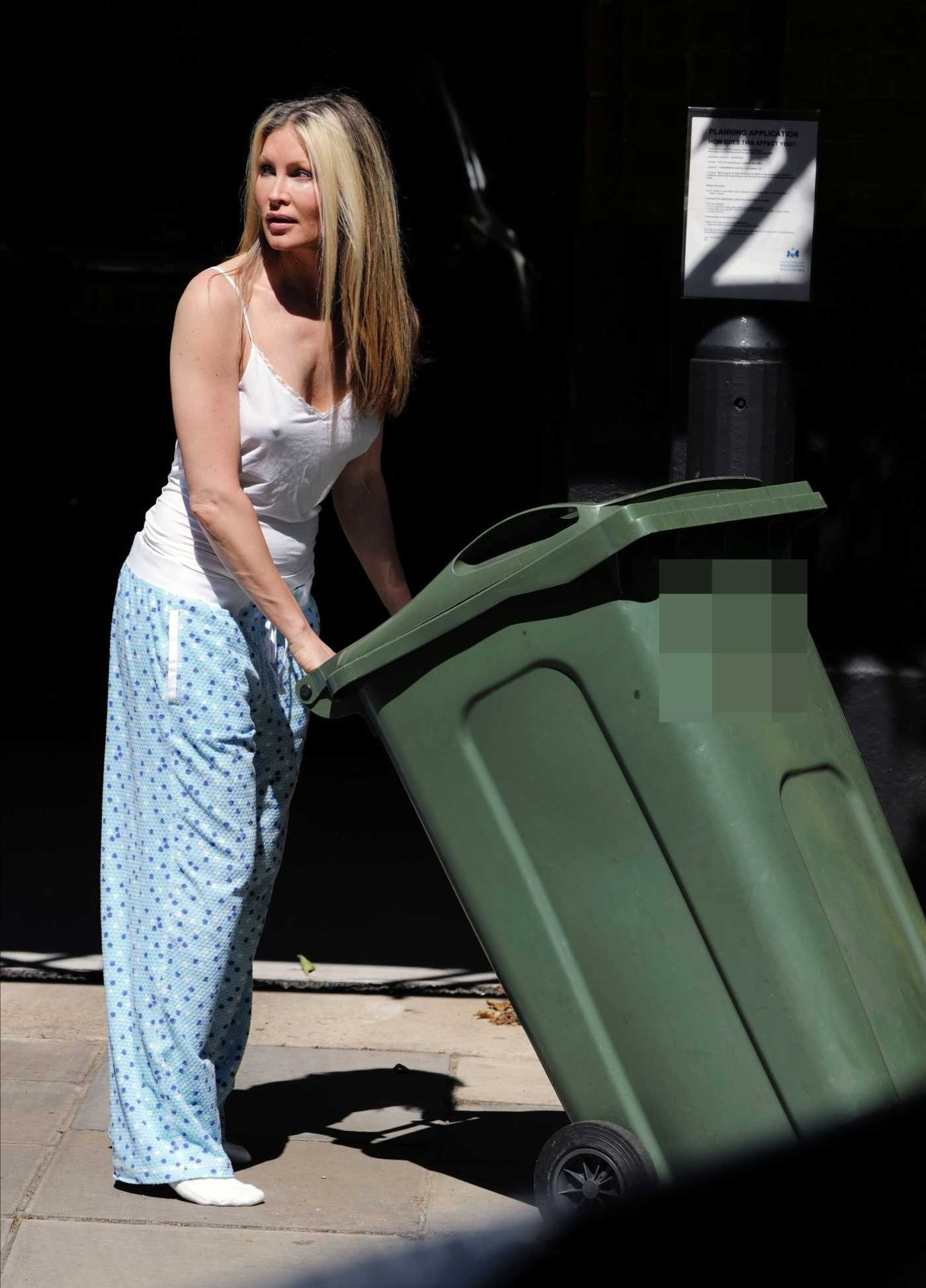 Caprice Bourret in a Light Blue Pajama Bottoms Takes the Bins Out in London 05/26/2020