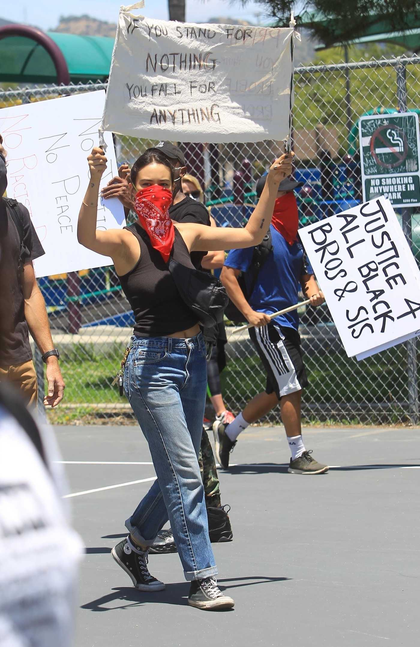 Courtney Eaton in a Red Bandana as a Face Mask Attends the Black Lives Matter Protest in Los Angeles 05/30/2020