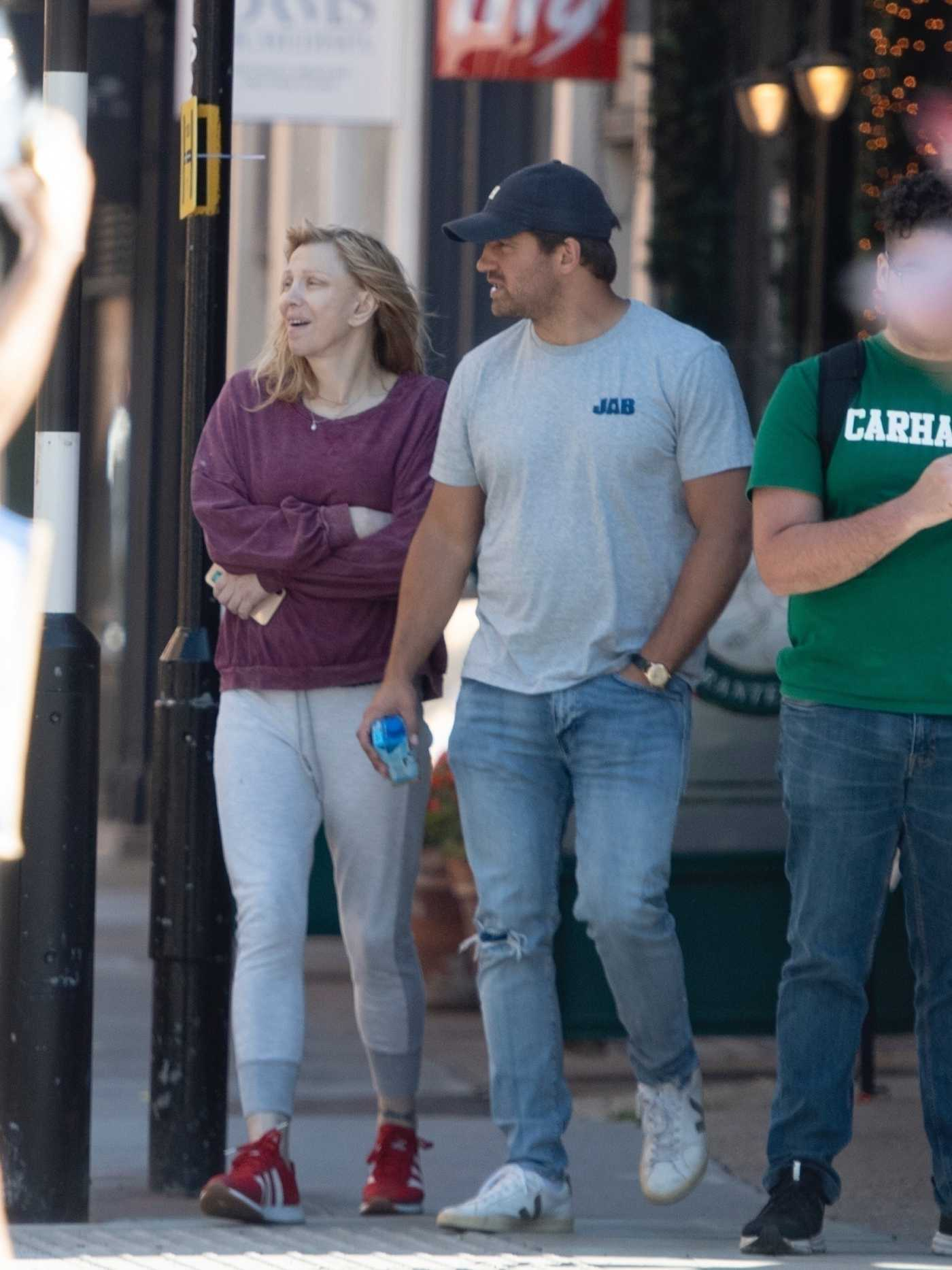 Courtney Love in a Purple Sweatshirt Was Seen Out with Alex Hemsley in London 05/29/2020