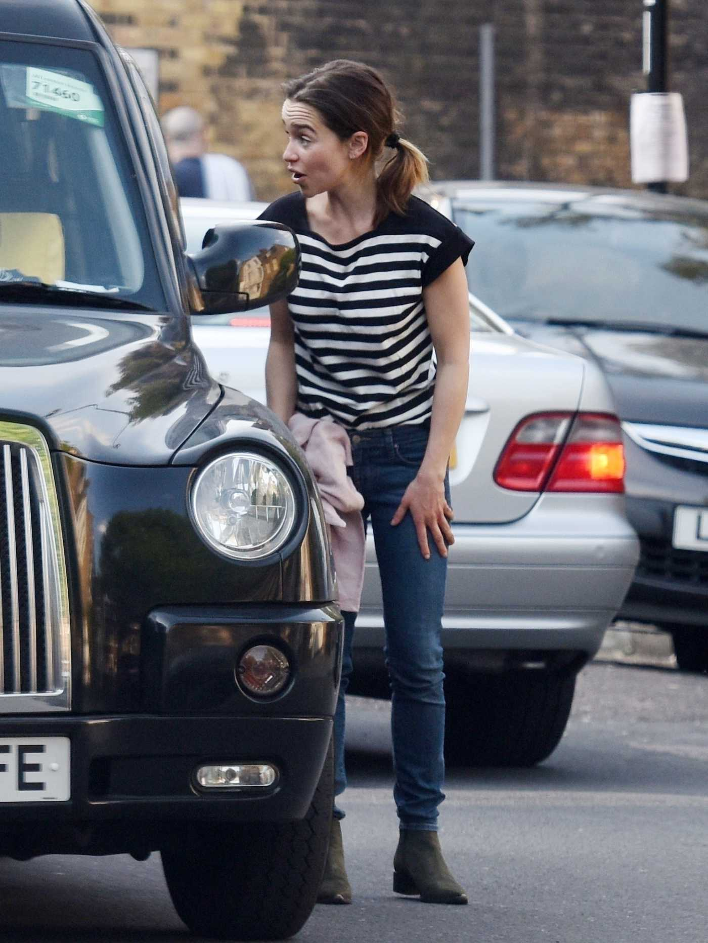 Emilia Clarke in a Striped Tee Asks a Cab Driver to Deliver a Package in London 05/07/2020