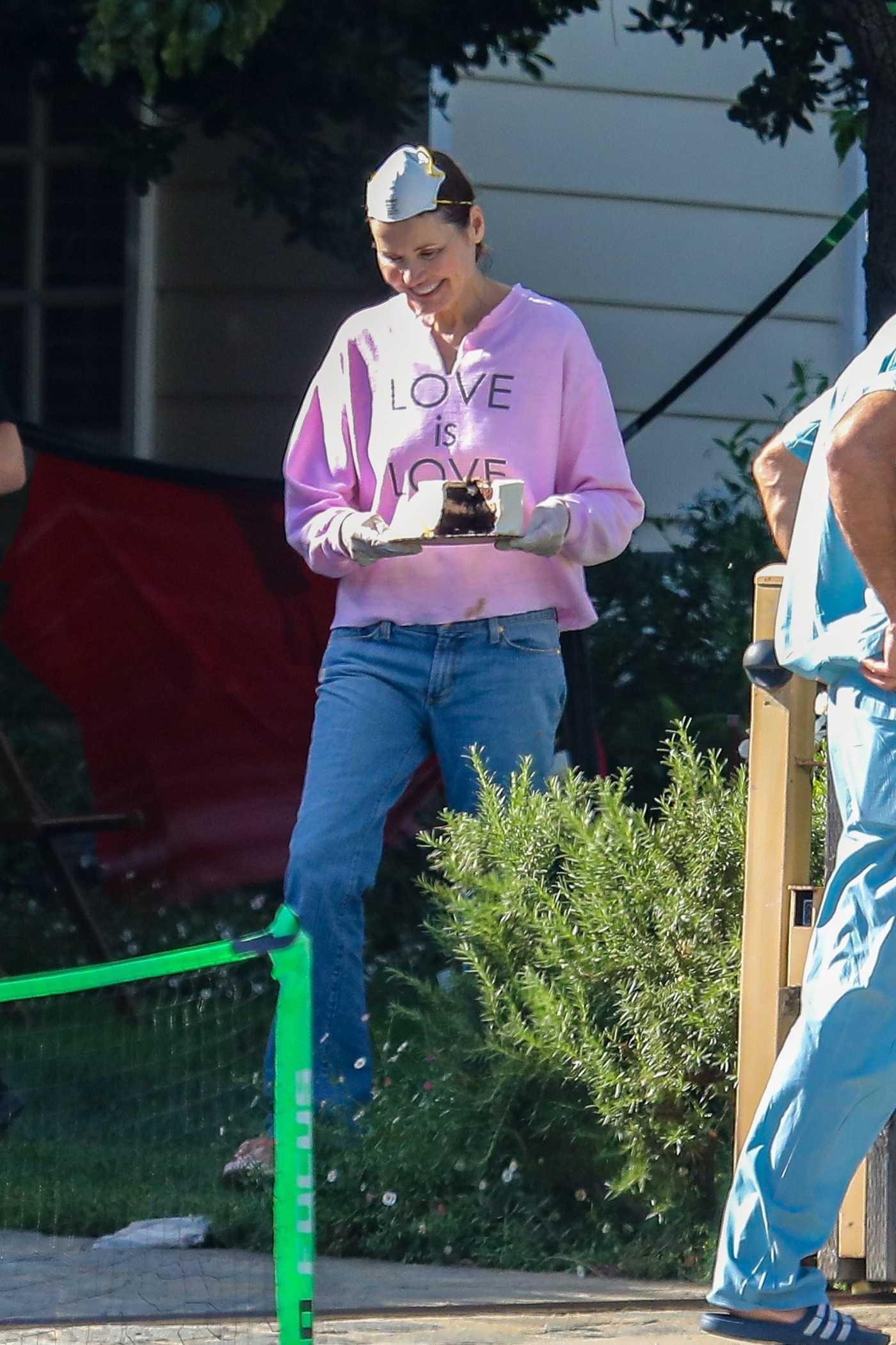 Geena Davis Enjoys Cake in the Front Yard of Her Home in Pacific Palisades 05/06/2020