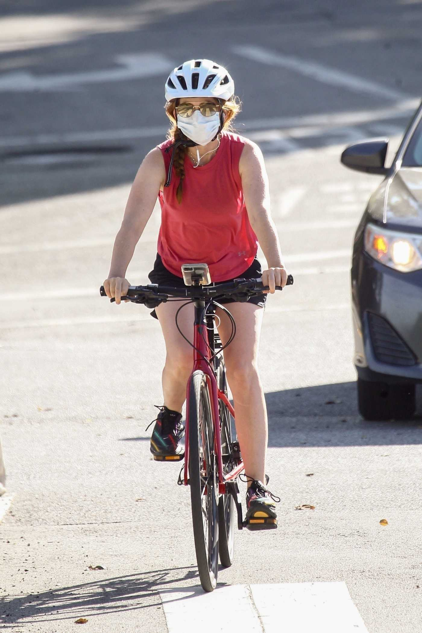 Isla Fisher in a Red Tank Top Goes for a Spin on Her Bike in Beverly Hills 05/07/2020